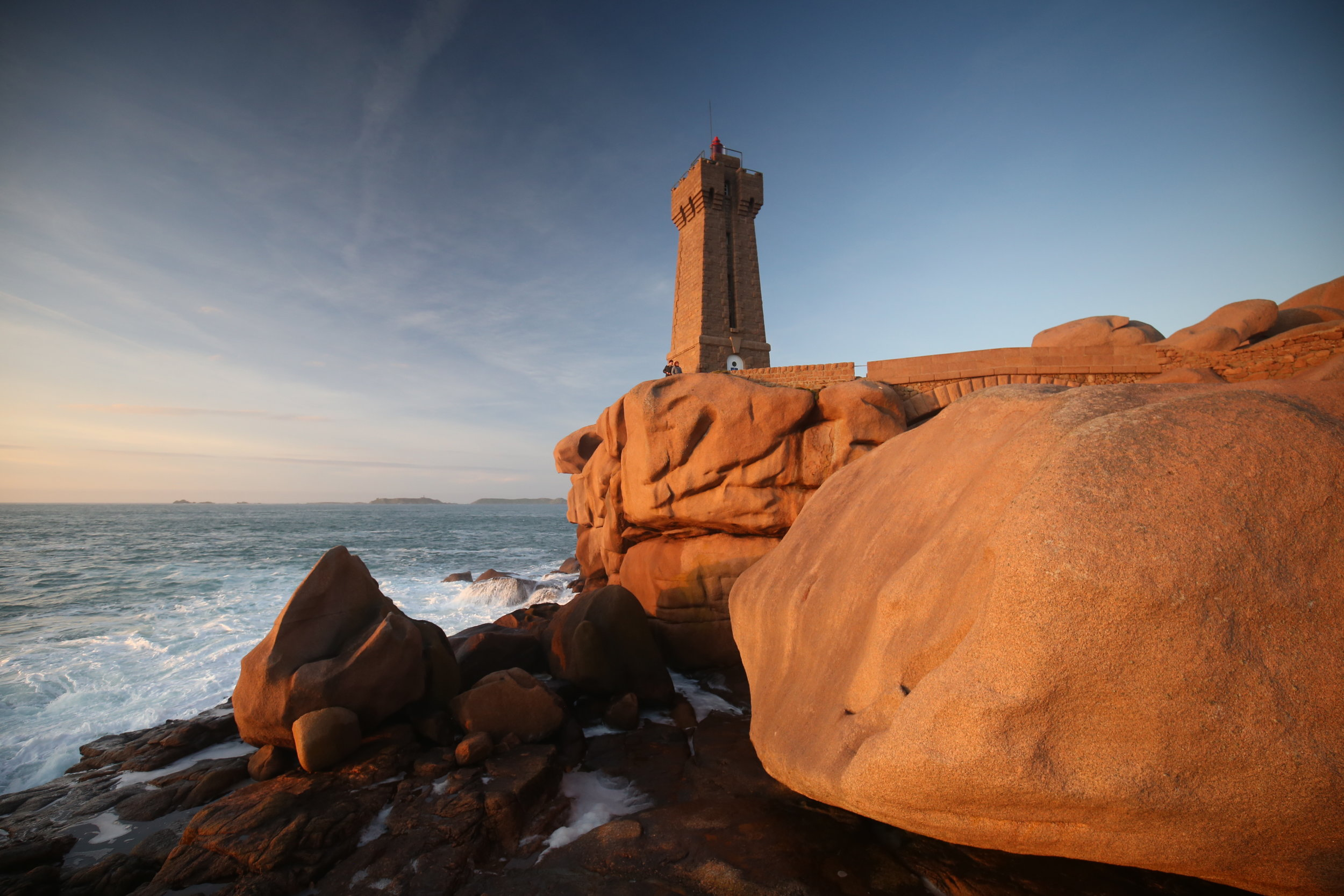 Ploumanach lighthouse made of rose granite stone, on the coast of Brittany, France.