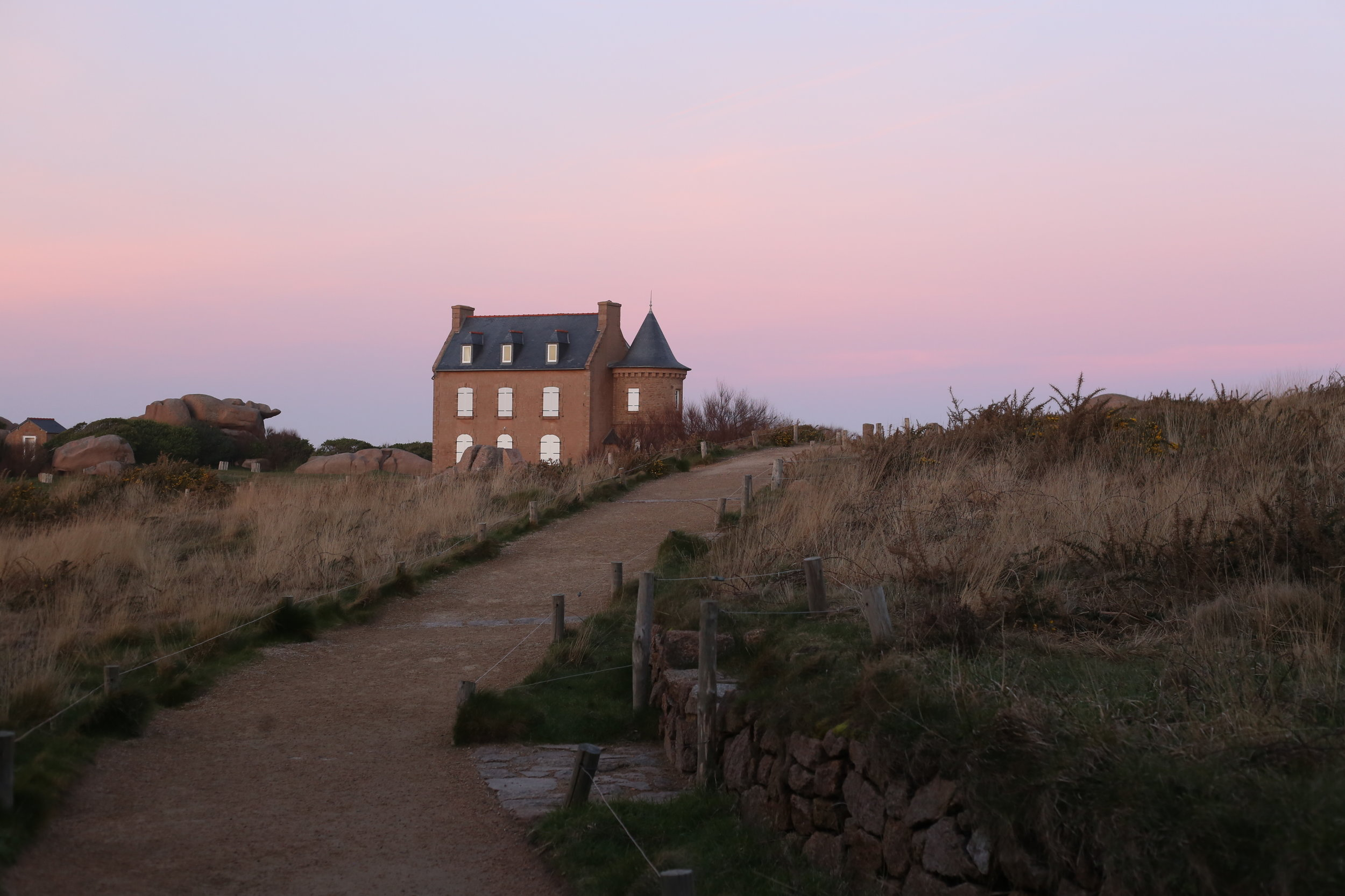 Purple skies over a manor house, on the coast of Brittany.