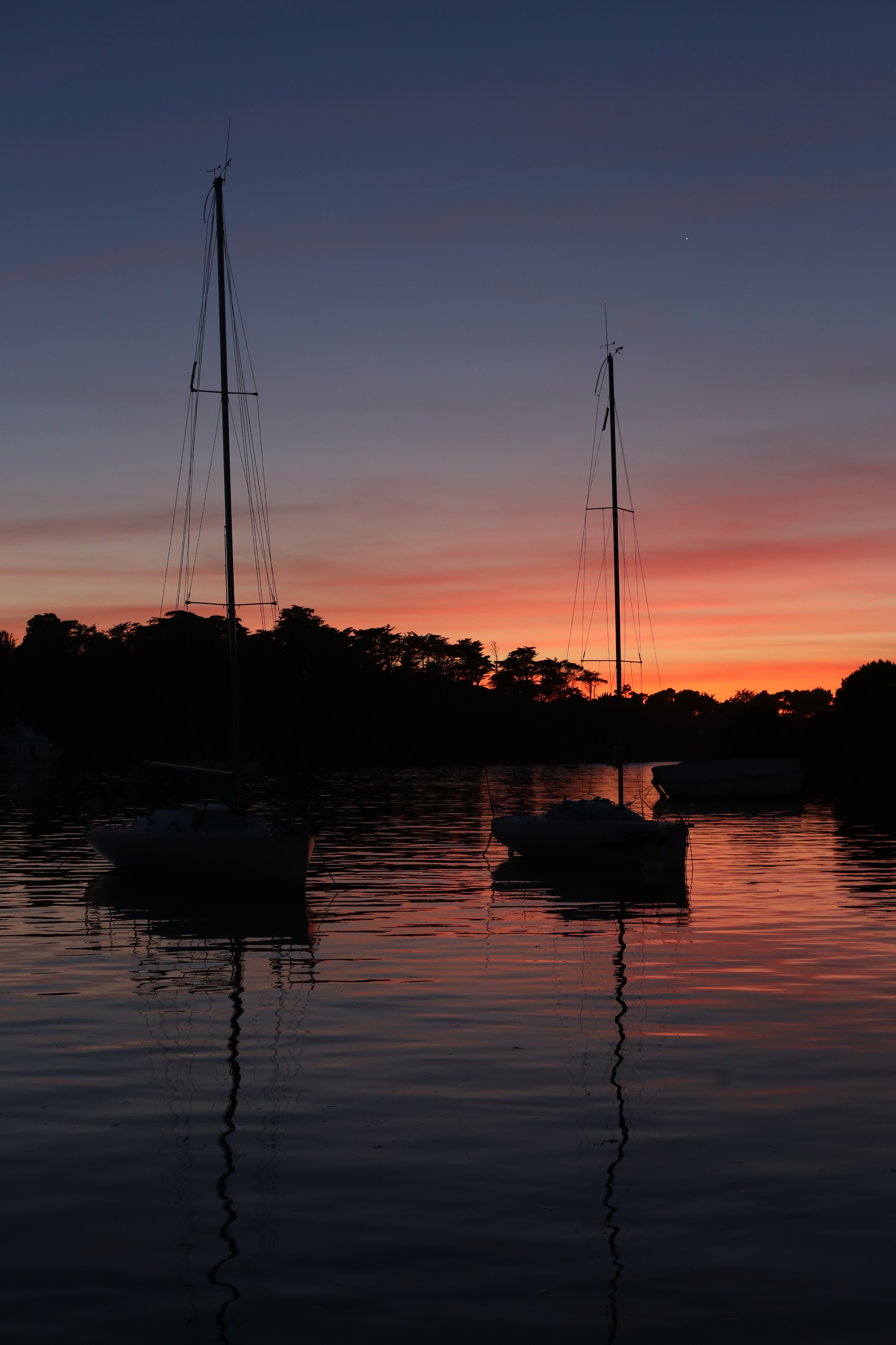 Boats at sunset under a purple sky, Brittany.