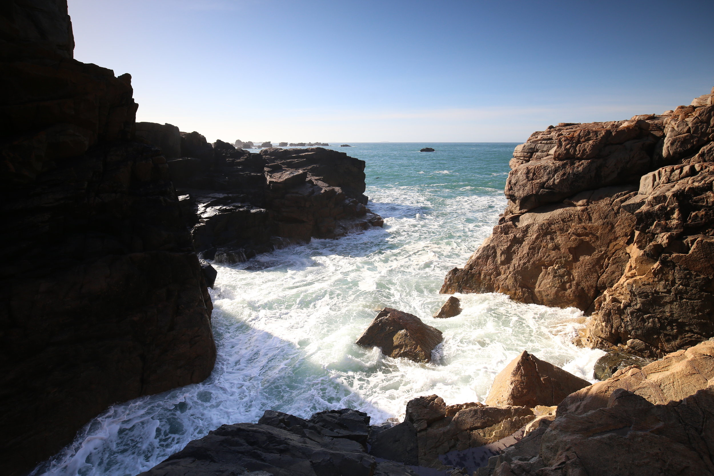 Sea spray in an alcove of rocks on the Rose Coast.