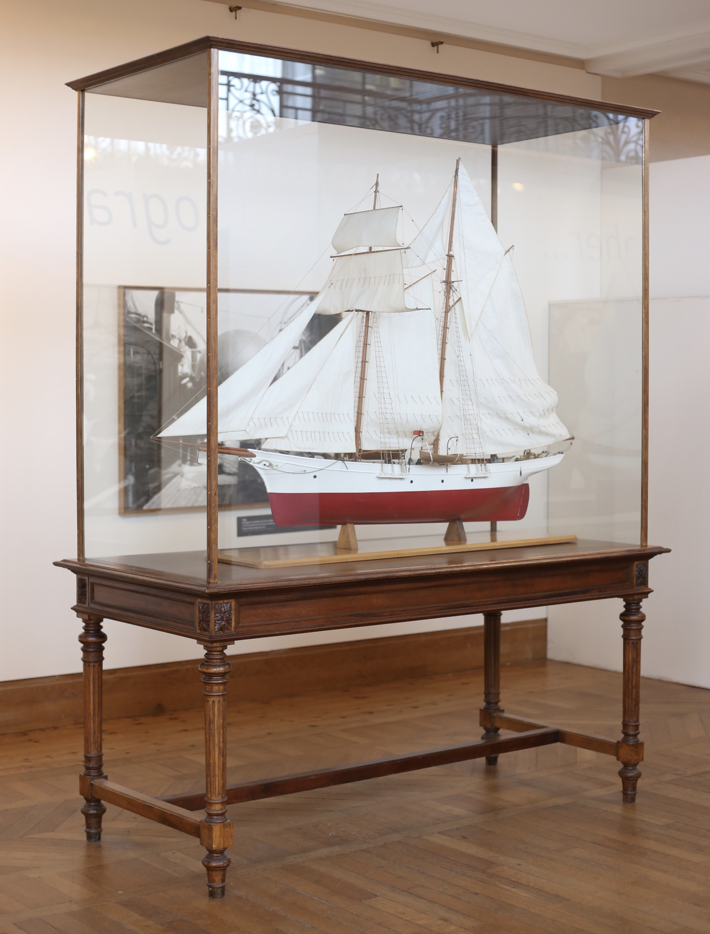 An old glass cabinet with a model ship inside - Monaco's aquarium museum.