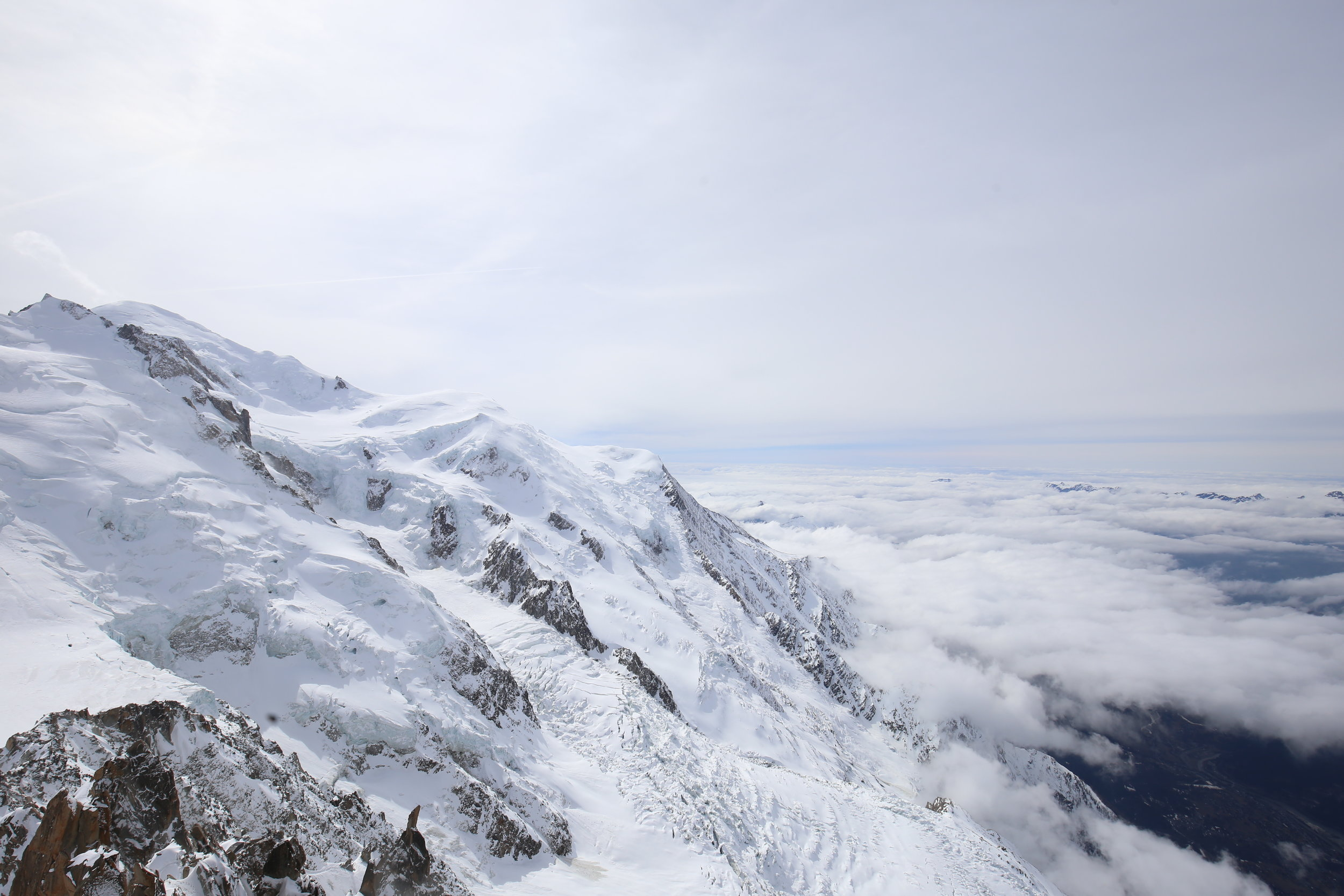 The view over Chamonix valley from the top of Mont Blanc Aiguille du Midi.