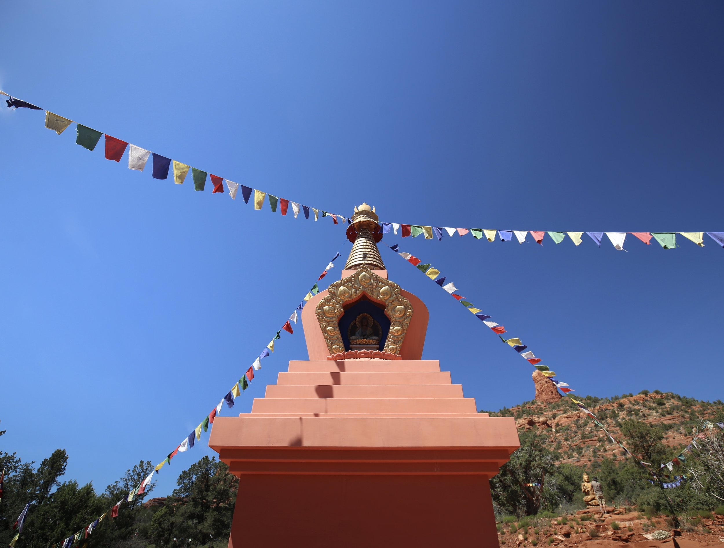 The peace stupa of Sedona, with prayer flags flying.