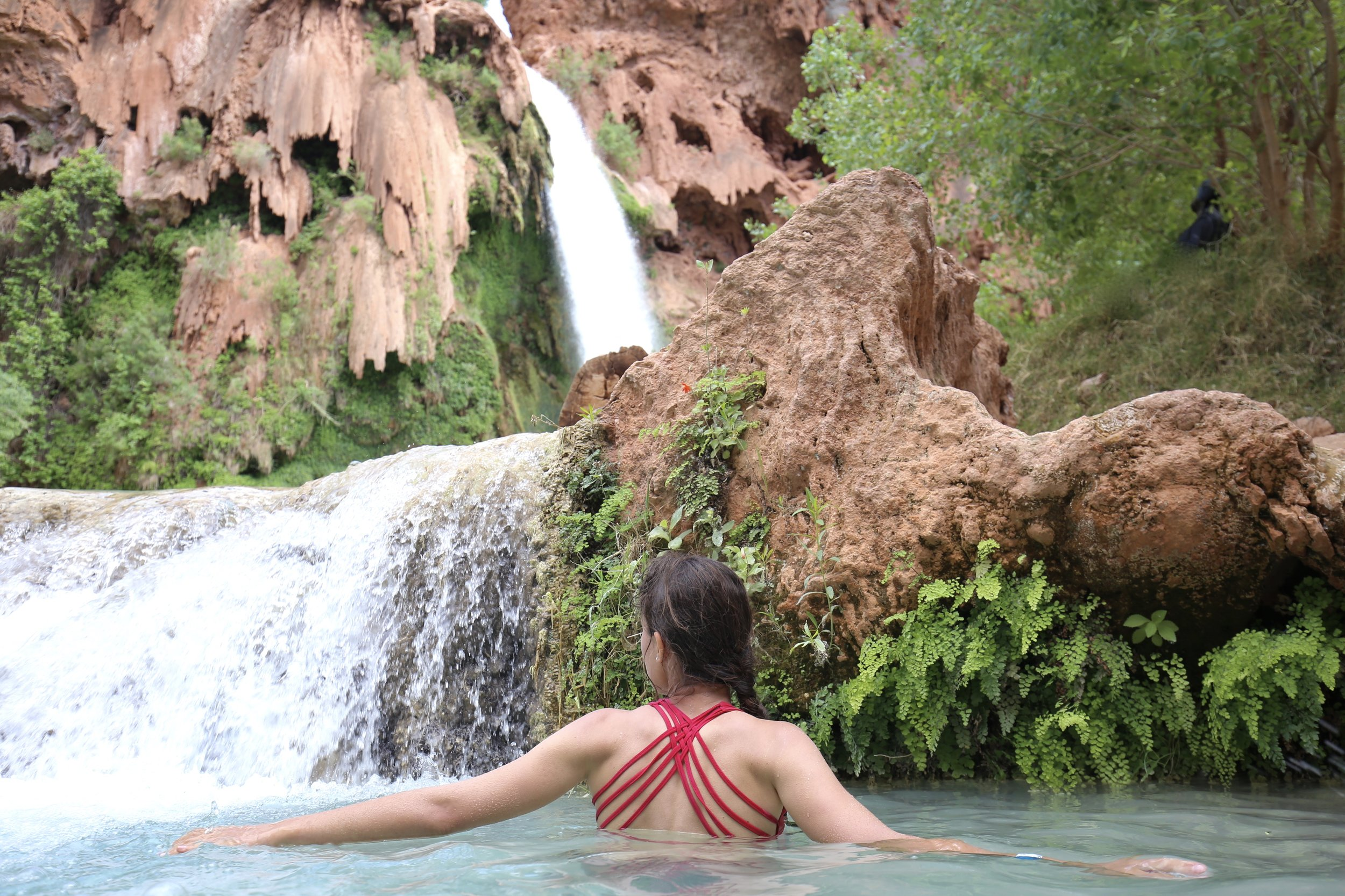 Swimming in the clear blue-green waters of Havasu Falls - real mermaid.