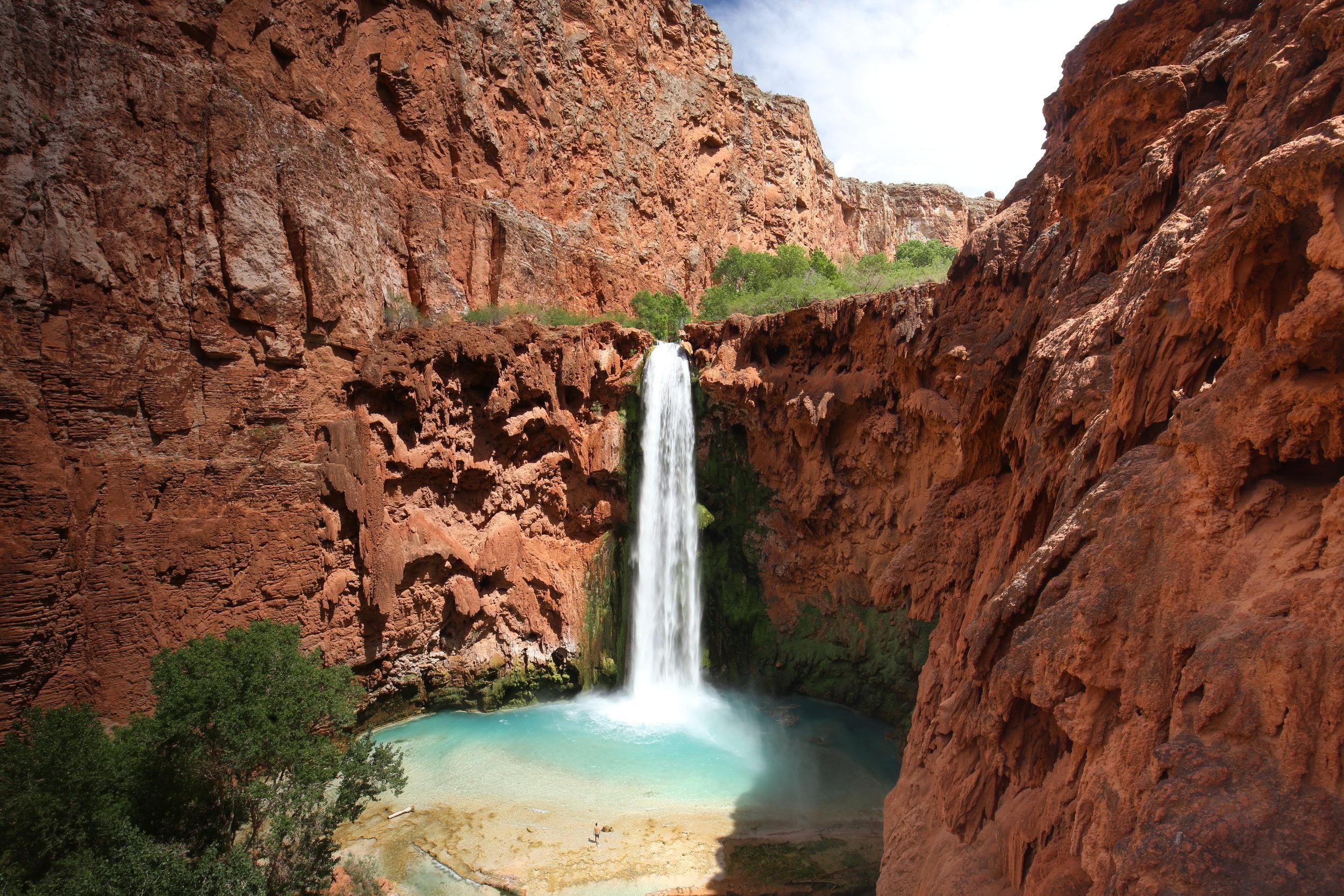 The incredible Mooney Waterfall at Havasupai. Crystal blue waters in red rocks.