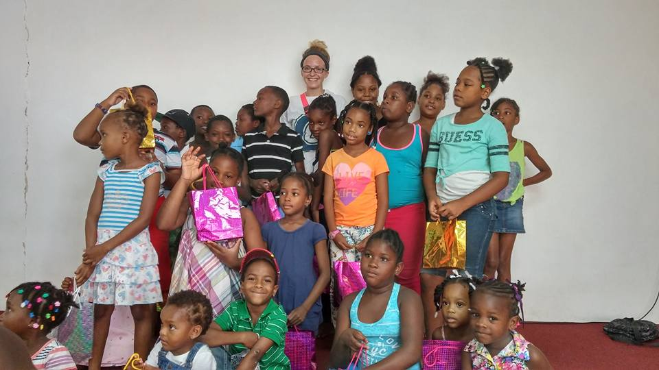 2016 Summer MIssion Adventure participants pose with Kids they just ministered to in Castries