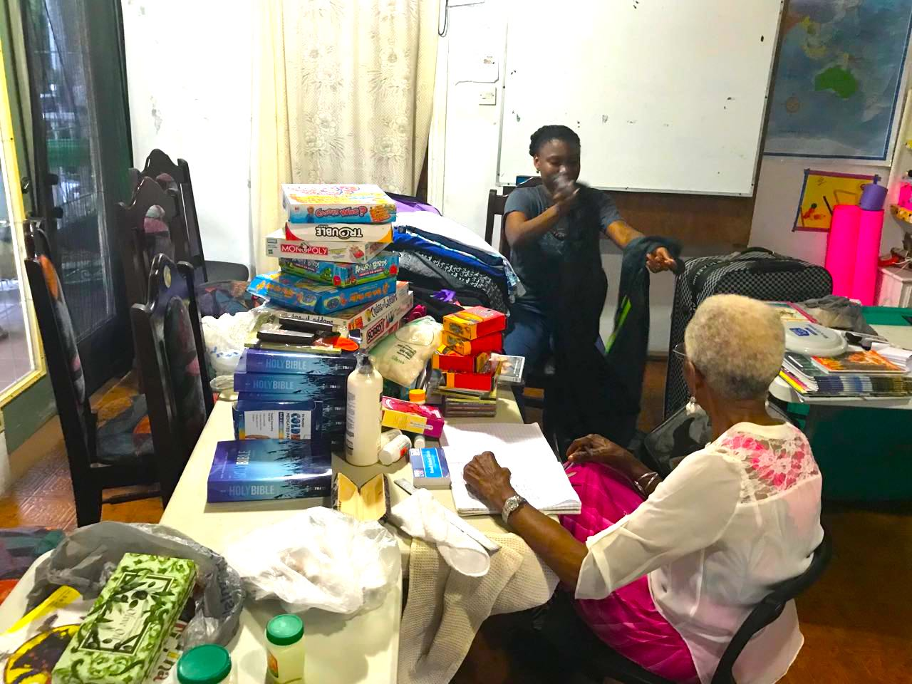 SORTING GIFTS FOR DONATION AT YWAM SL.jpg