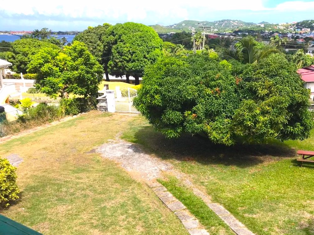 View of the yard from upstair balcony
