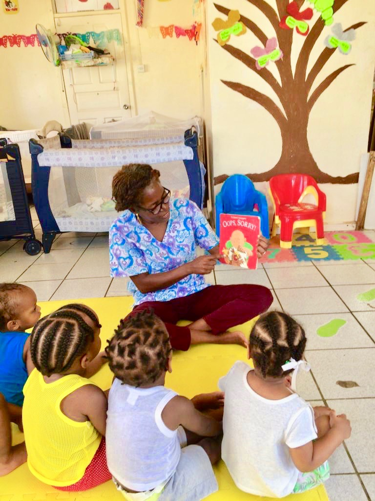 Marylin With Children at the Preschool