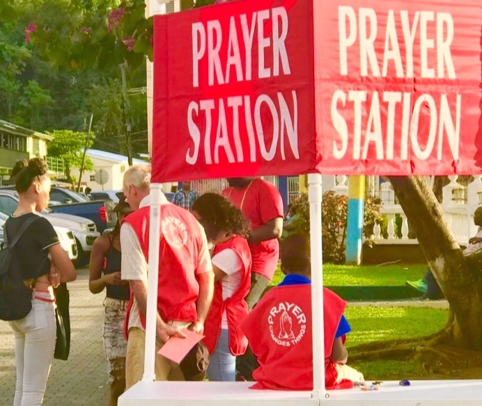A young person asking for prayer at the Prayer Station