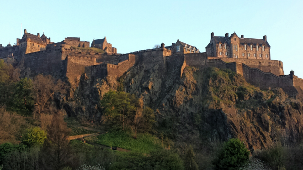 Majestic Edinburgh Castle at sunset.