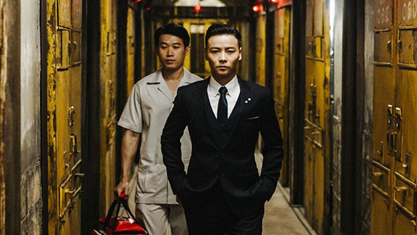 Corrupt warden Ko Hung (Jin Zhang)enjoys music, martial arts, and taking long strolls through the dirty hall of his prison.
