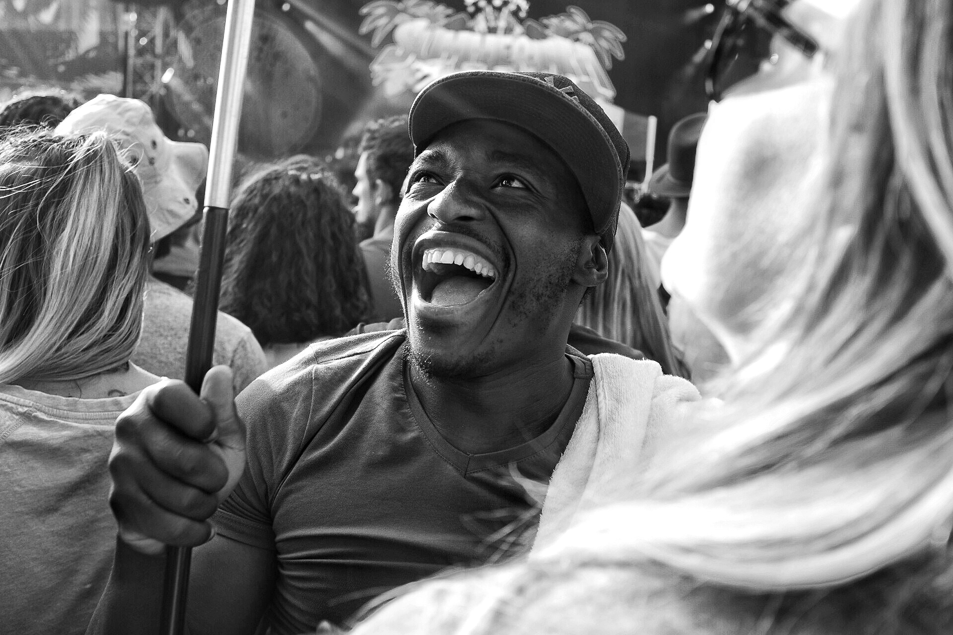 Smile from a Kenyan holding his country's flag
