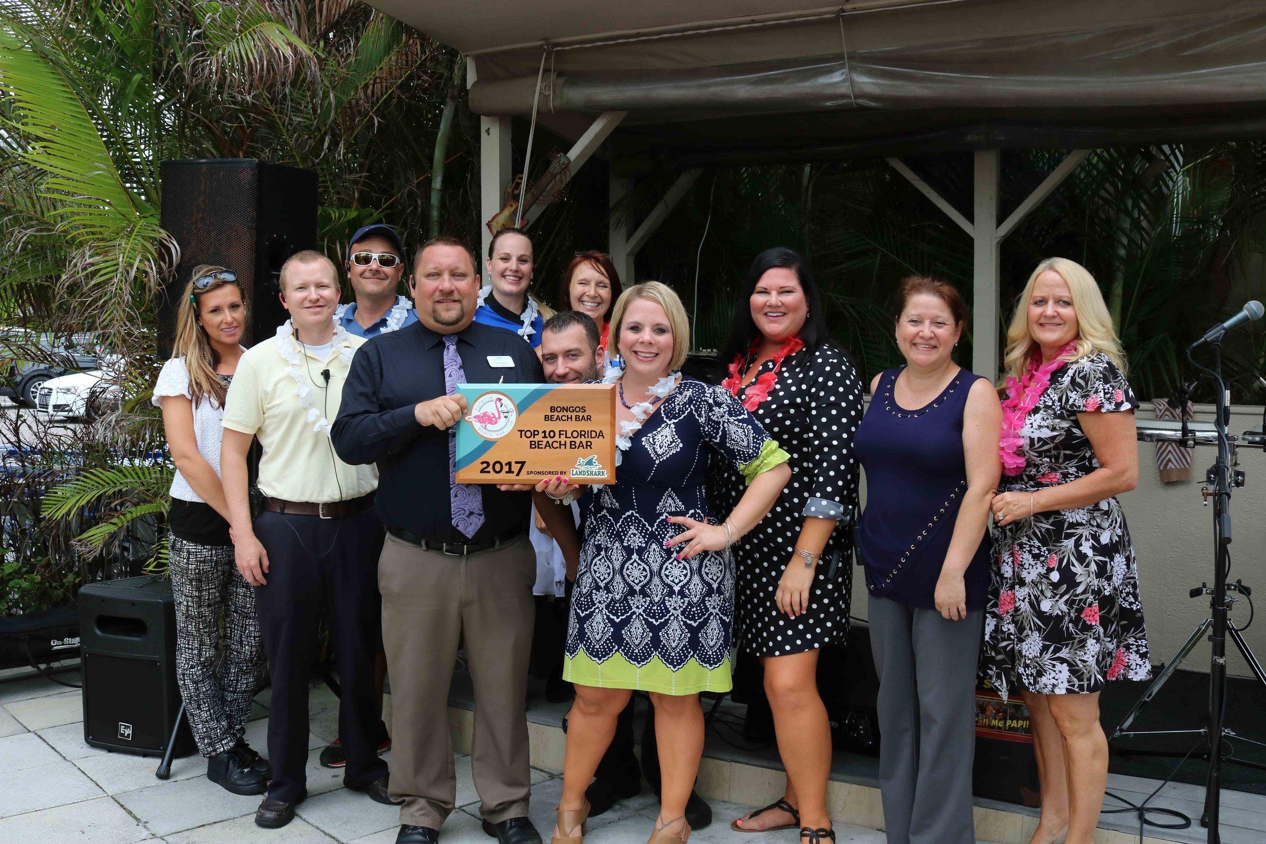 The staff of Bongos Beach Bar accepts the 2017 Top Florida Beach Bar award.