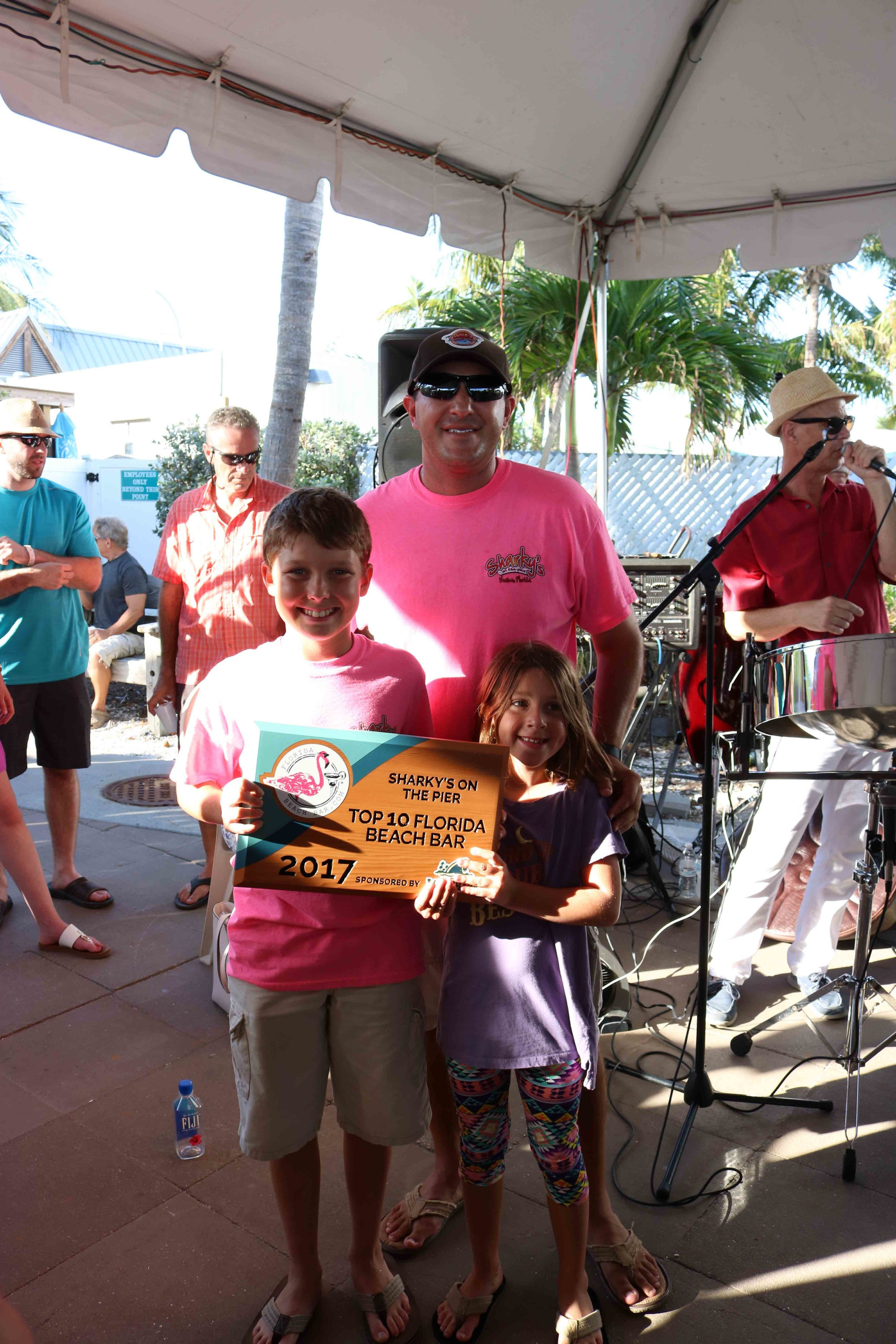 Justin and his family accept the 2017 Top 10 Florida Beach Bar award