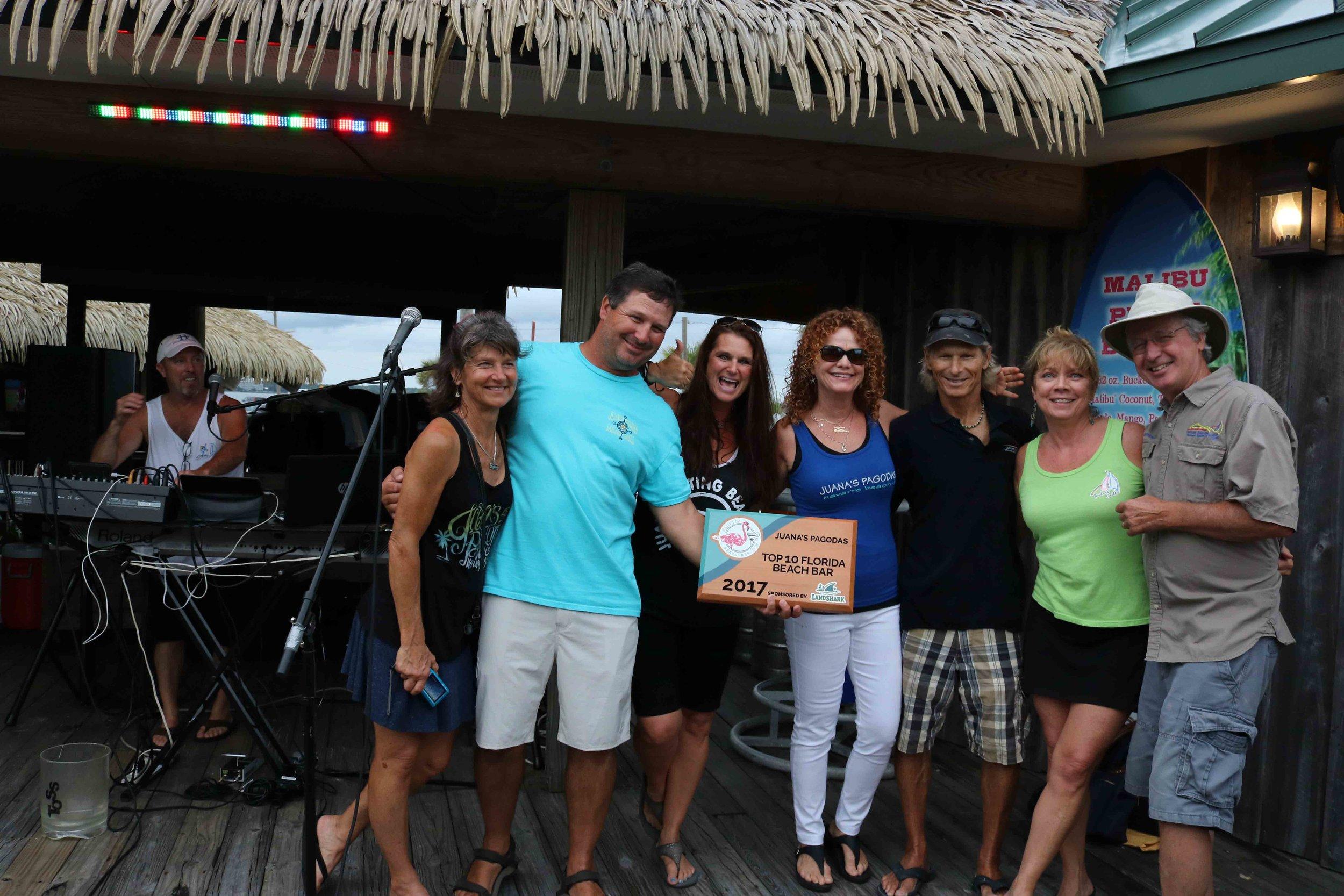 Kevin and his family accept the 2017 Top 10 Florida Beach Bar award