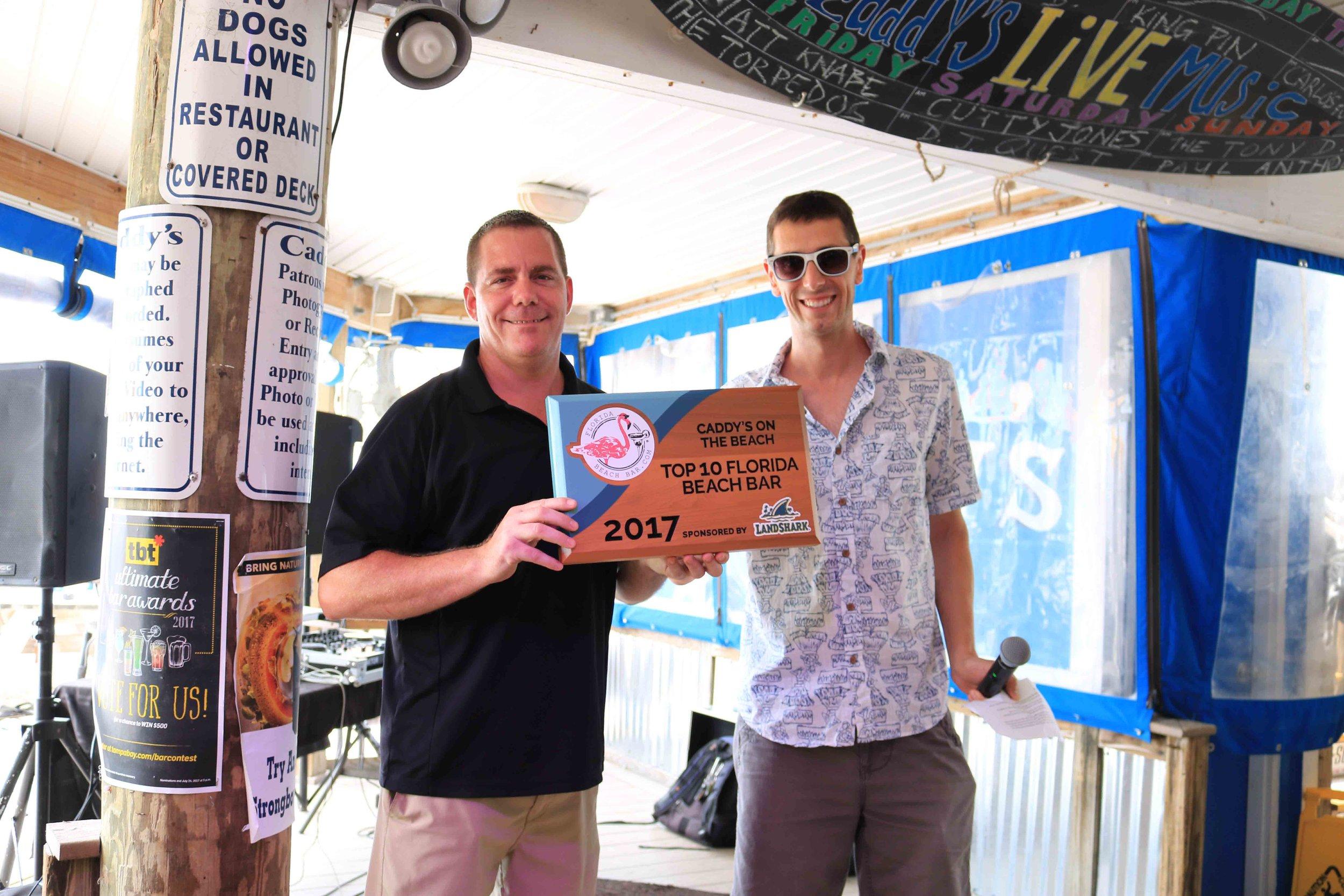 Caddy's General manager, Chris,accepts the 2017 Top 10 Florida Beach Bar award