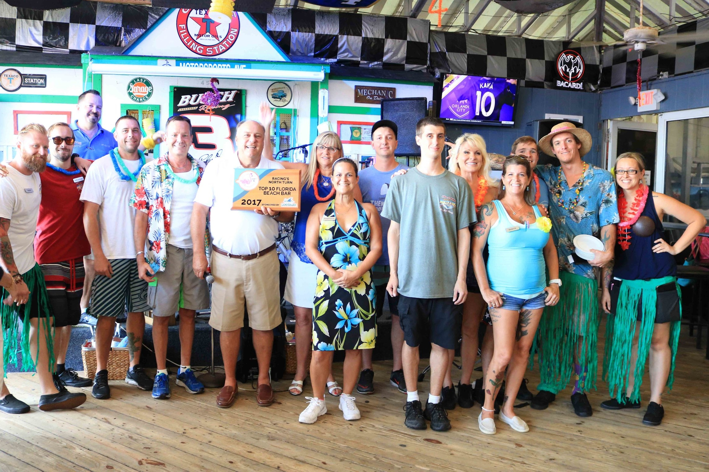 The staff of Racing's North Turn pose with the 2017 Florida Beach Bar award