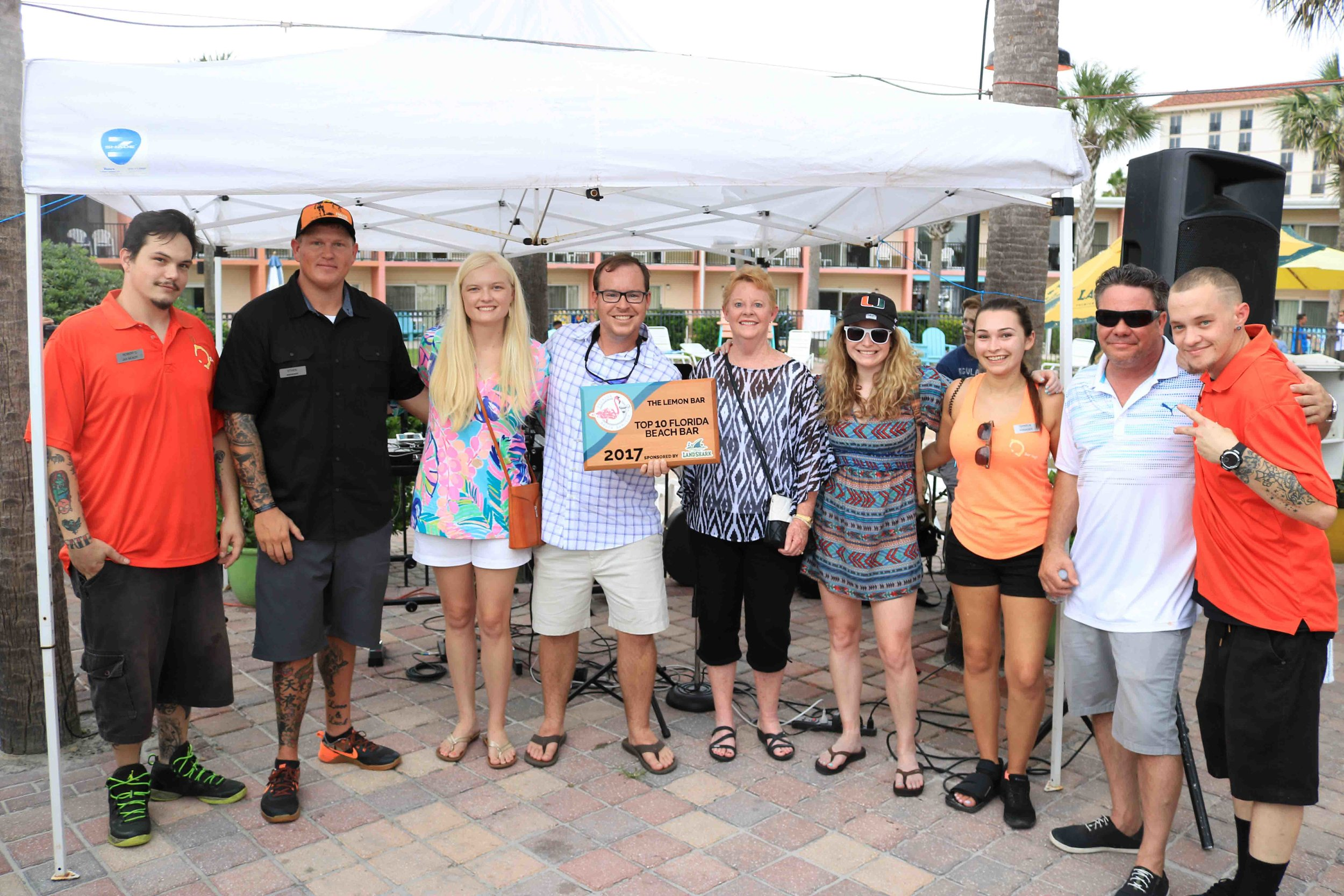 Some of the Lemon Bar staff poses for a picture with the 2017 Top 10 Florida Beach Bar award
