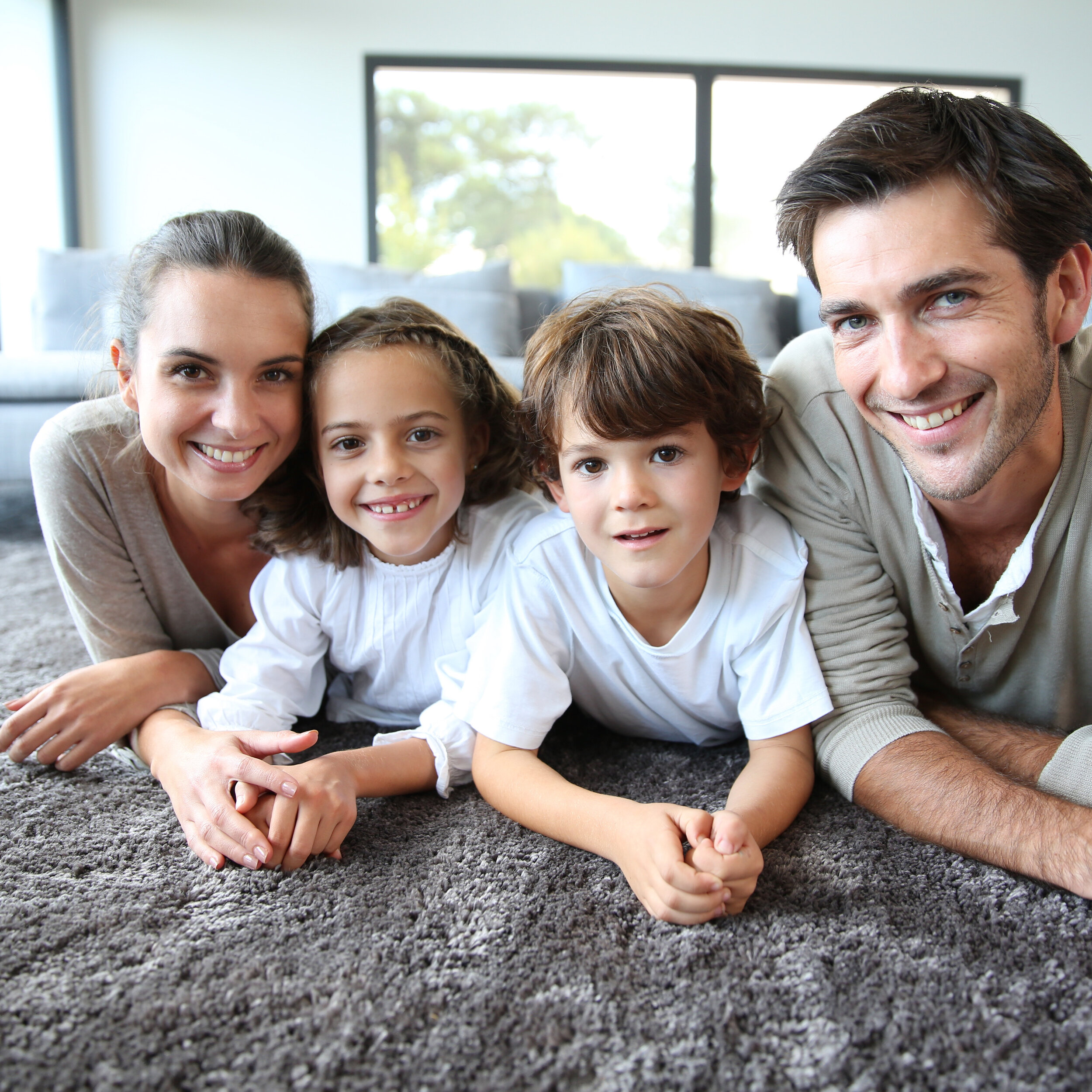 Family at home relaxing on carpet square.jpg