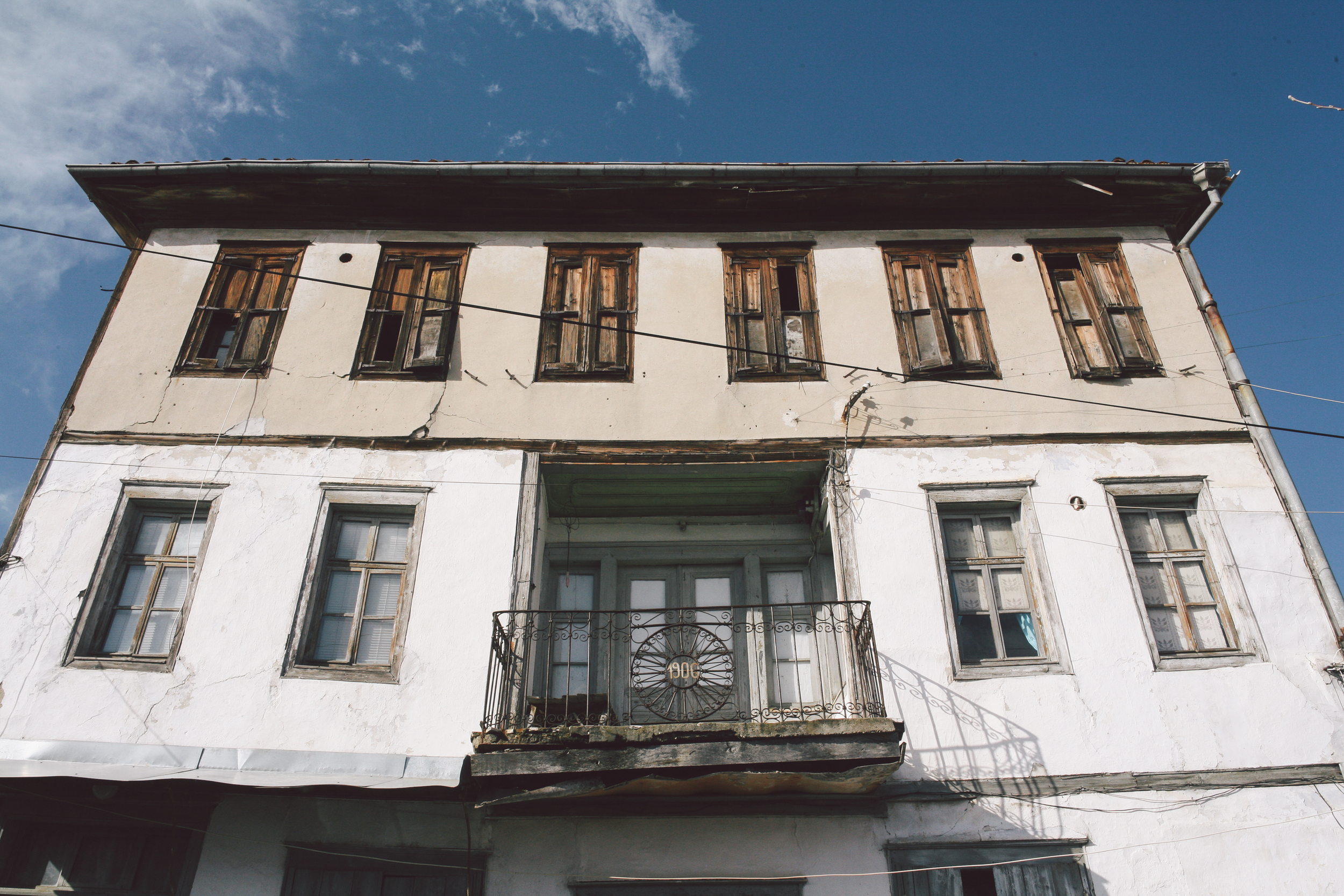 A neoclassical mansion in Ortakio with the year that it was constructed displayed on the balcony.