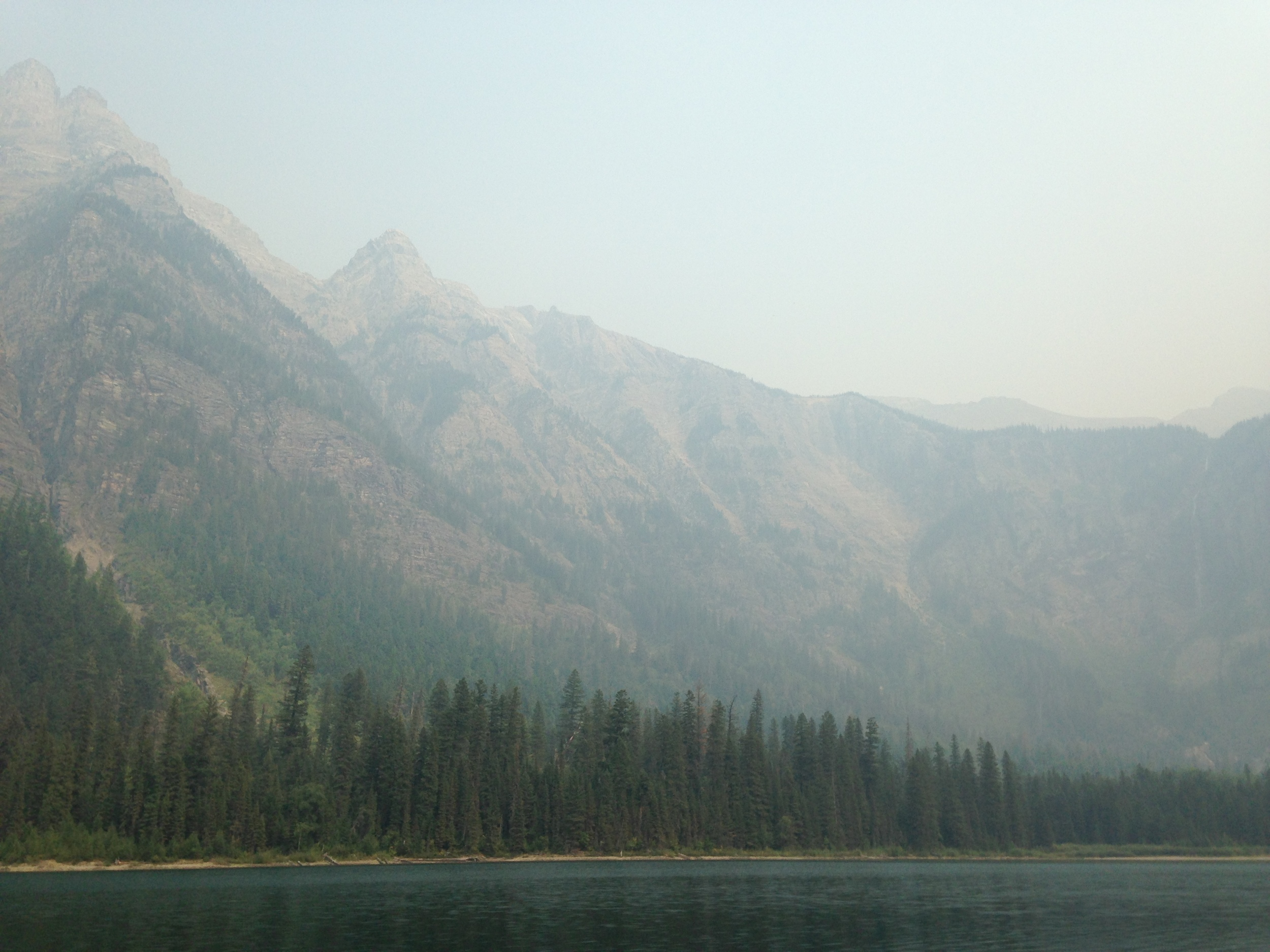 You can actually sorta see the mountains through the smoke here at Avalanche Lake, also in Glacier.