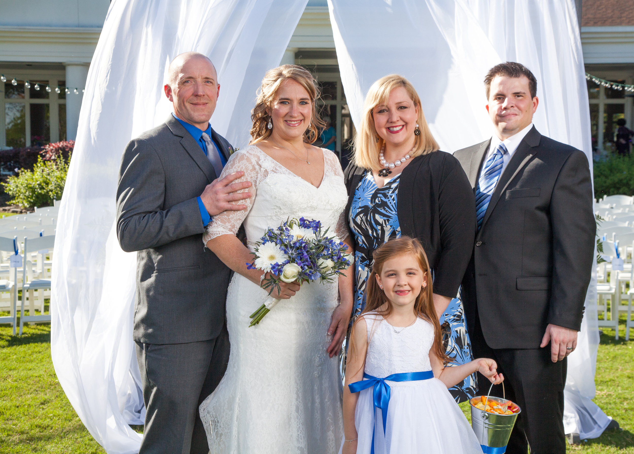 More group portraits with the arbor draped in shear white fabric at the background.