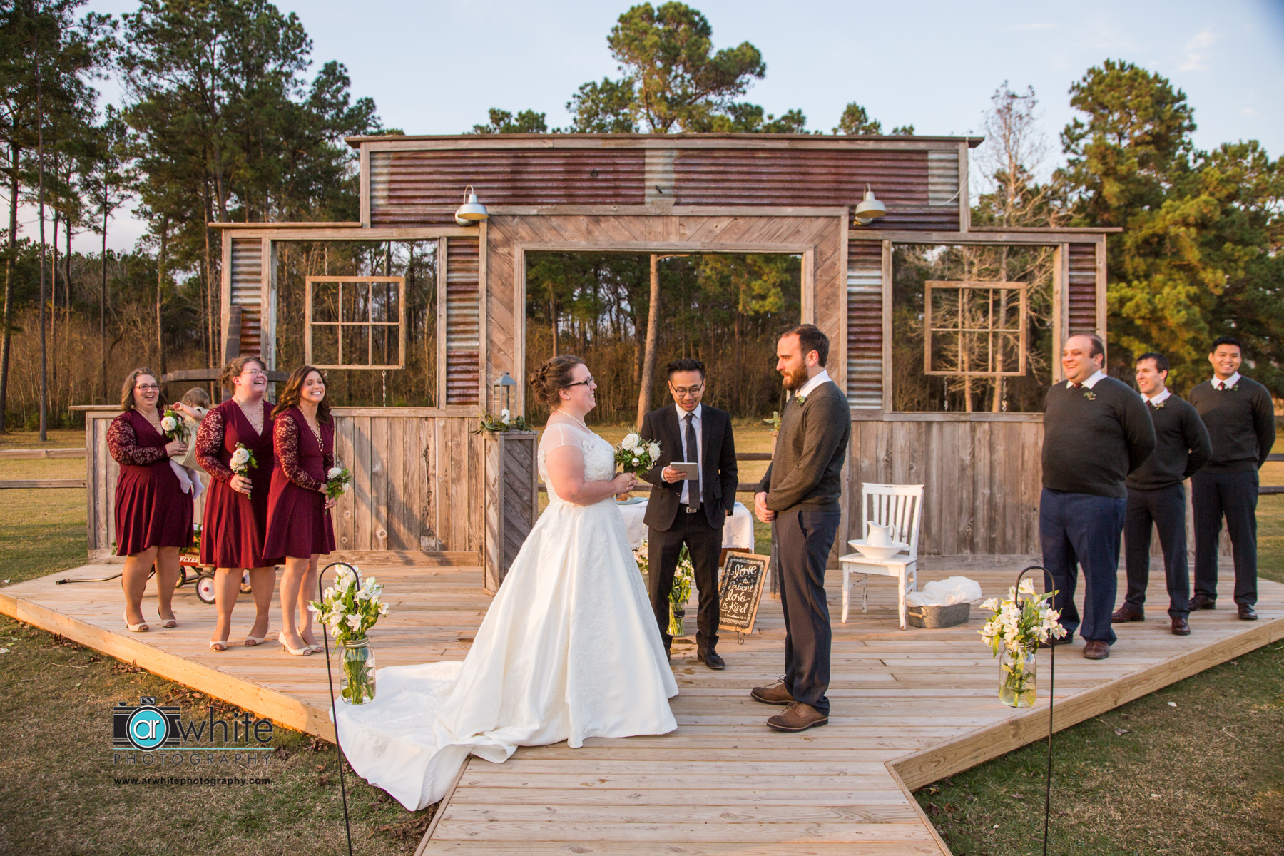 Wedding ceremony on a farm wedding and event barn venue.