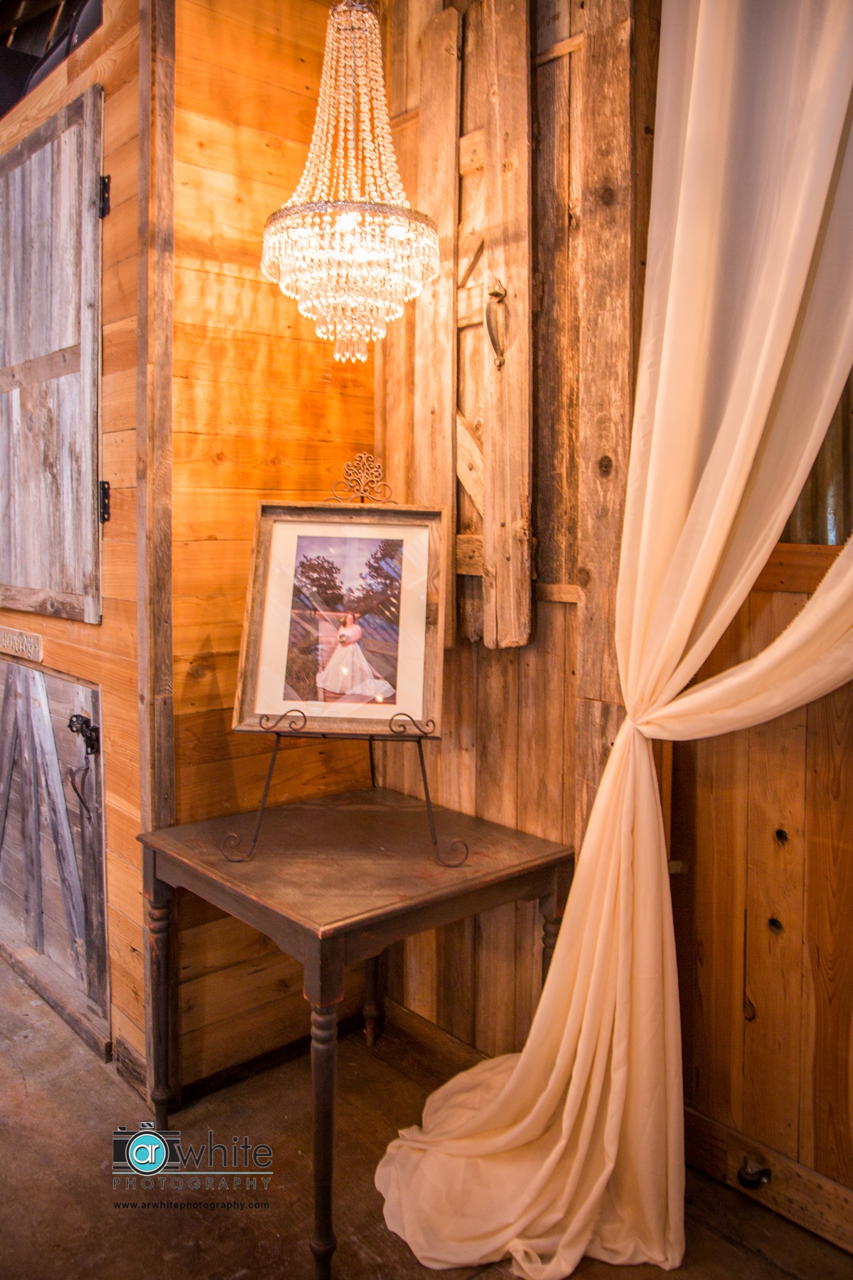 Detail of a photo display area at a barn wedding.