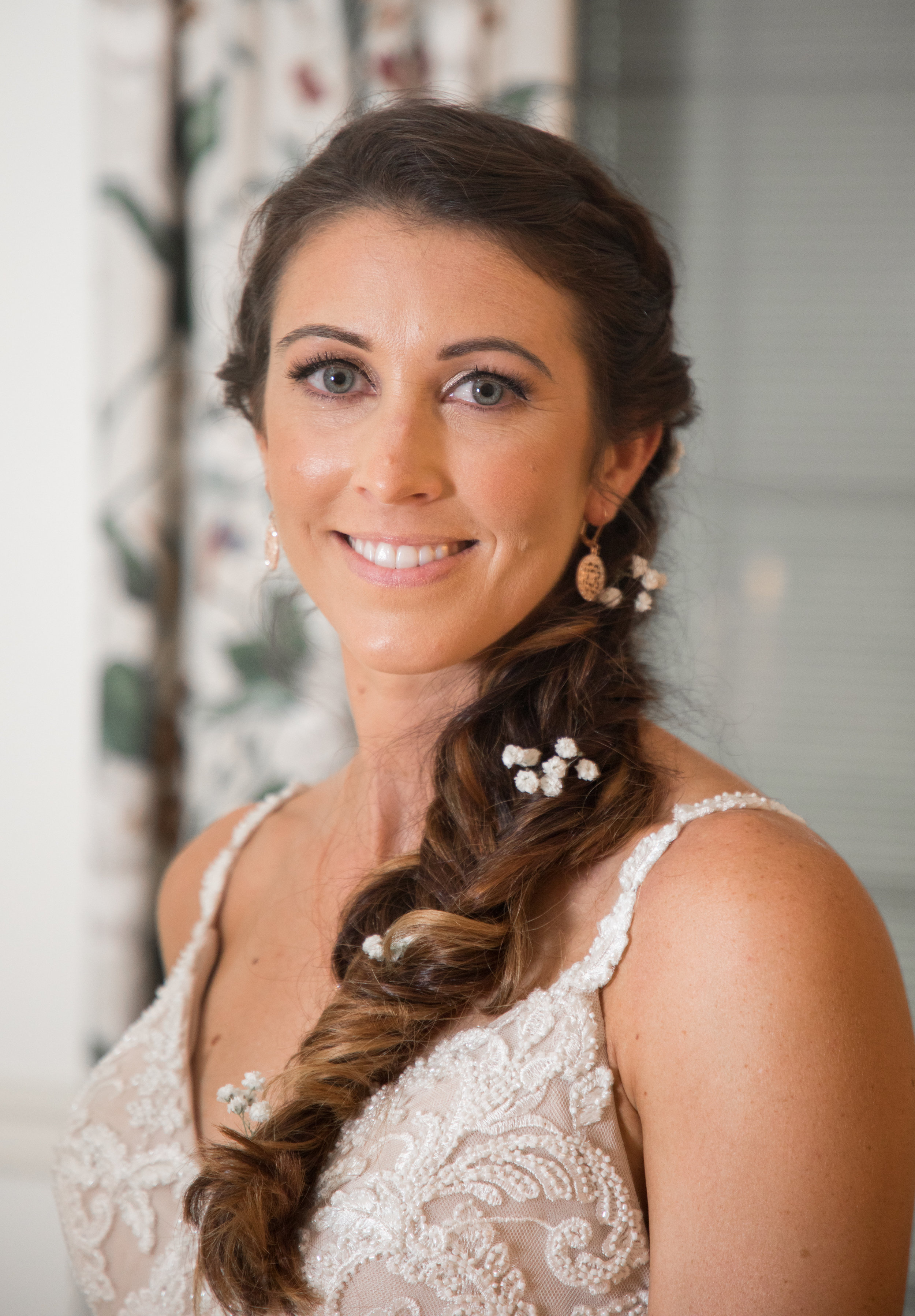 Babies breath flowers adorned Carri's hair which went perfectly with her nude wedding gown.