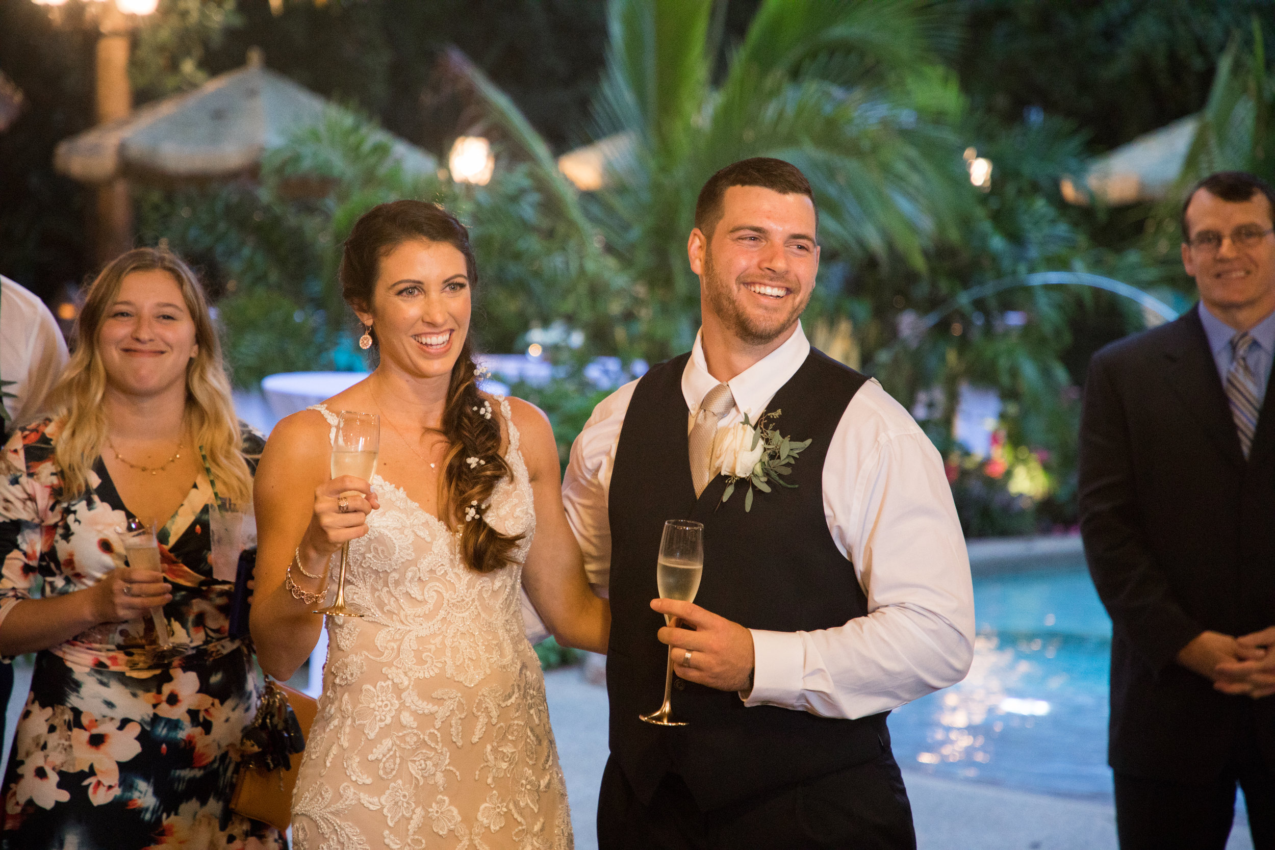 The couple laugh in response to a comment during the best man's toast.