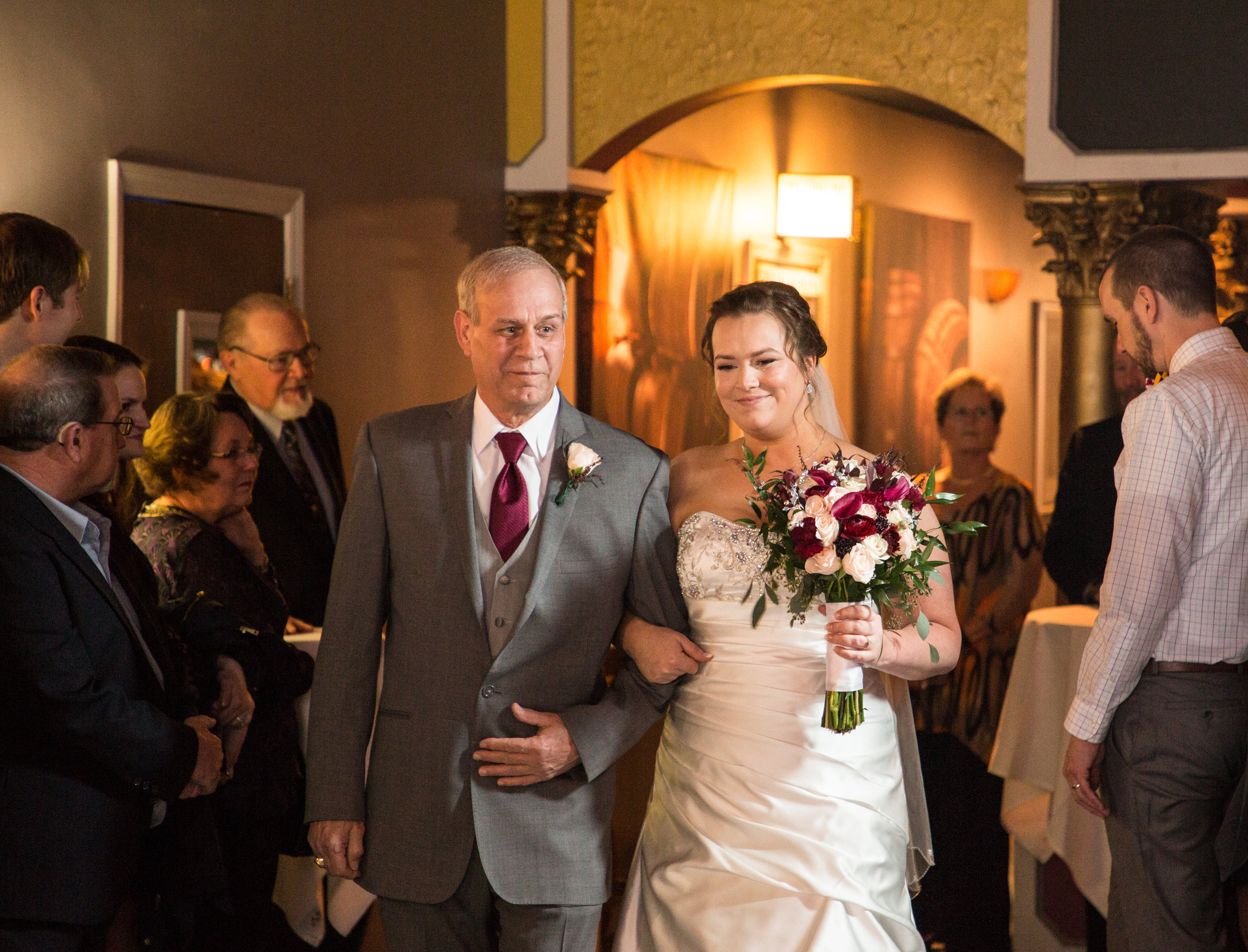 The bride is walked down the isle by her father at Ocean 13 in Ocean City.