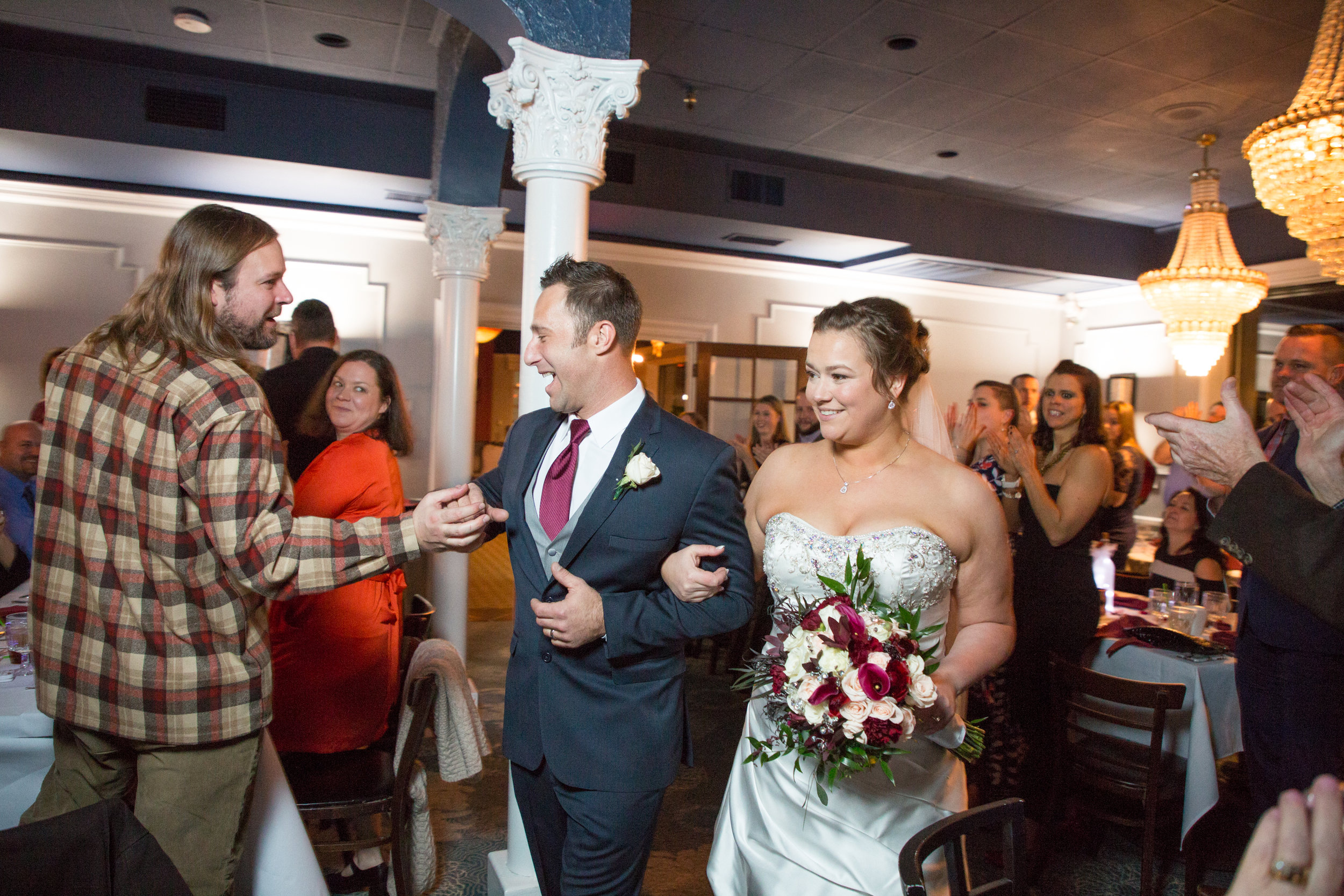 Jenna and Bill enter the reception hall during introductions during the reception on their wedding day in OC, MD.