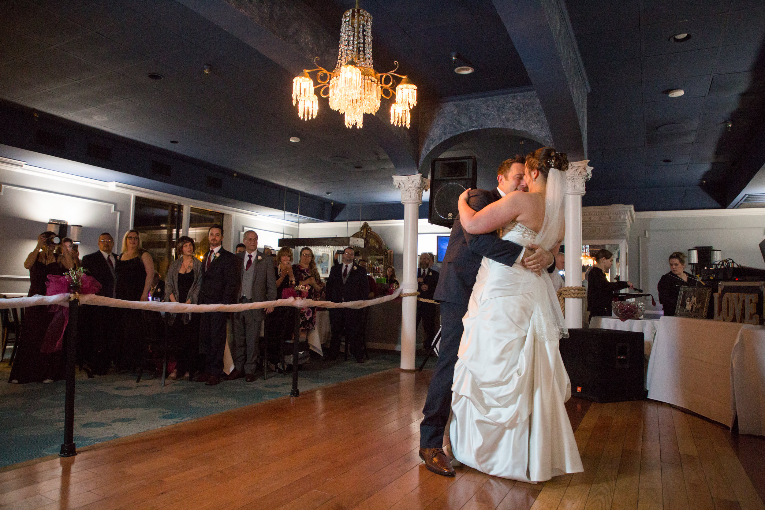 The bride and groom go right into their first dance after their entrance.