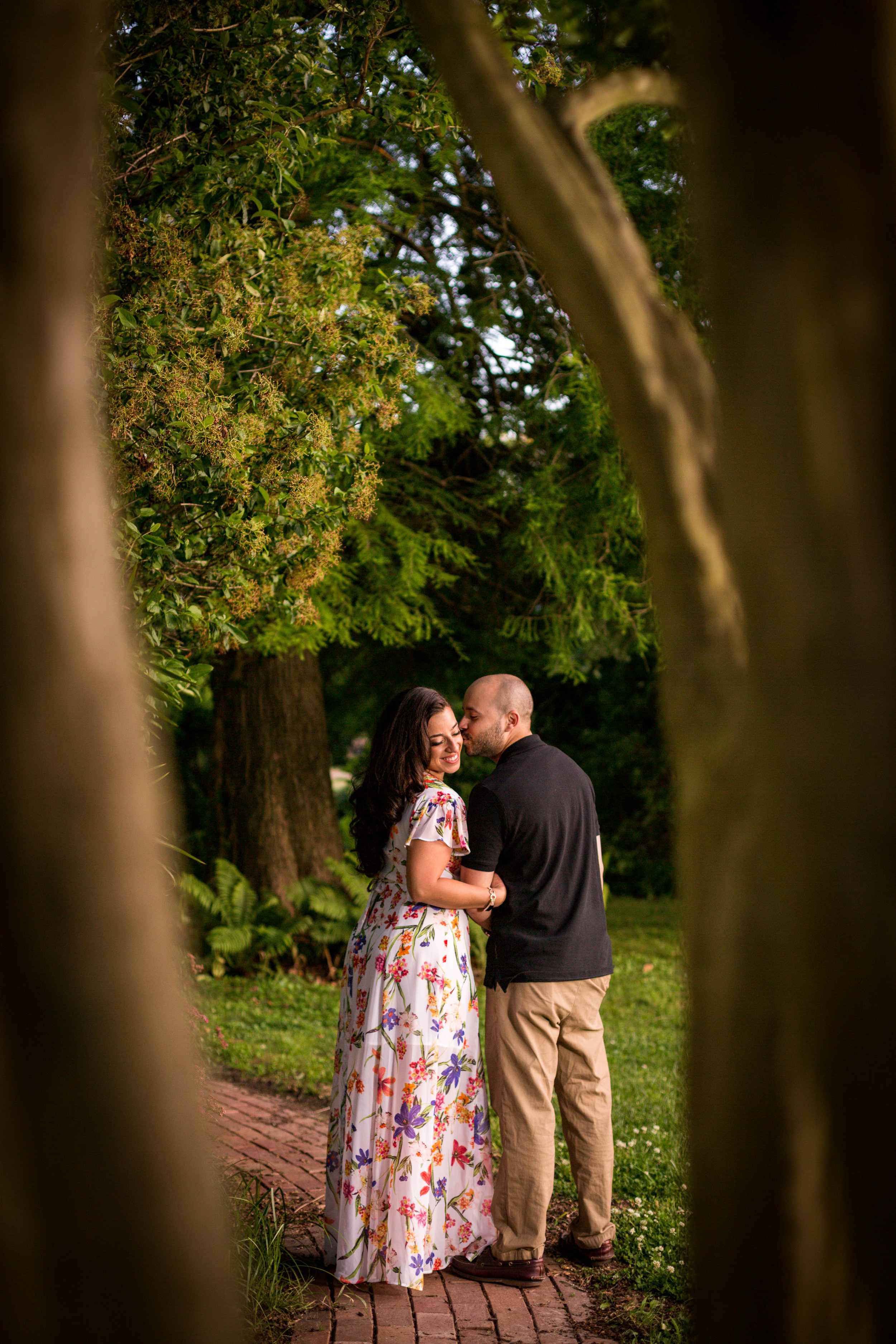 Engagement portrait taken on one of the many brick paths and gardens surrounding the mansion at Merry Sherwood in Berlin Md.