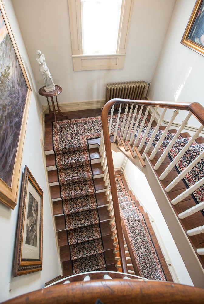 As a photographer, I am drawn to this staircase as I can easily imagine a bride with a long train cream or white wedding dress walking down for a first look with her groom at this amazing gem of a venue on Maryland's eastern shore.