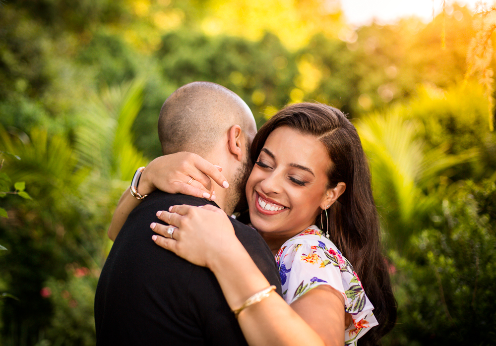 The happy engaged couple share in a moment under the glow of the setting sun in the historic Maryland garden of Merry Sherwood plantation.