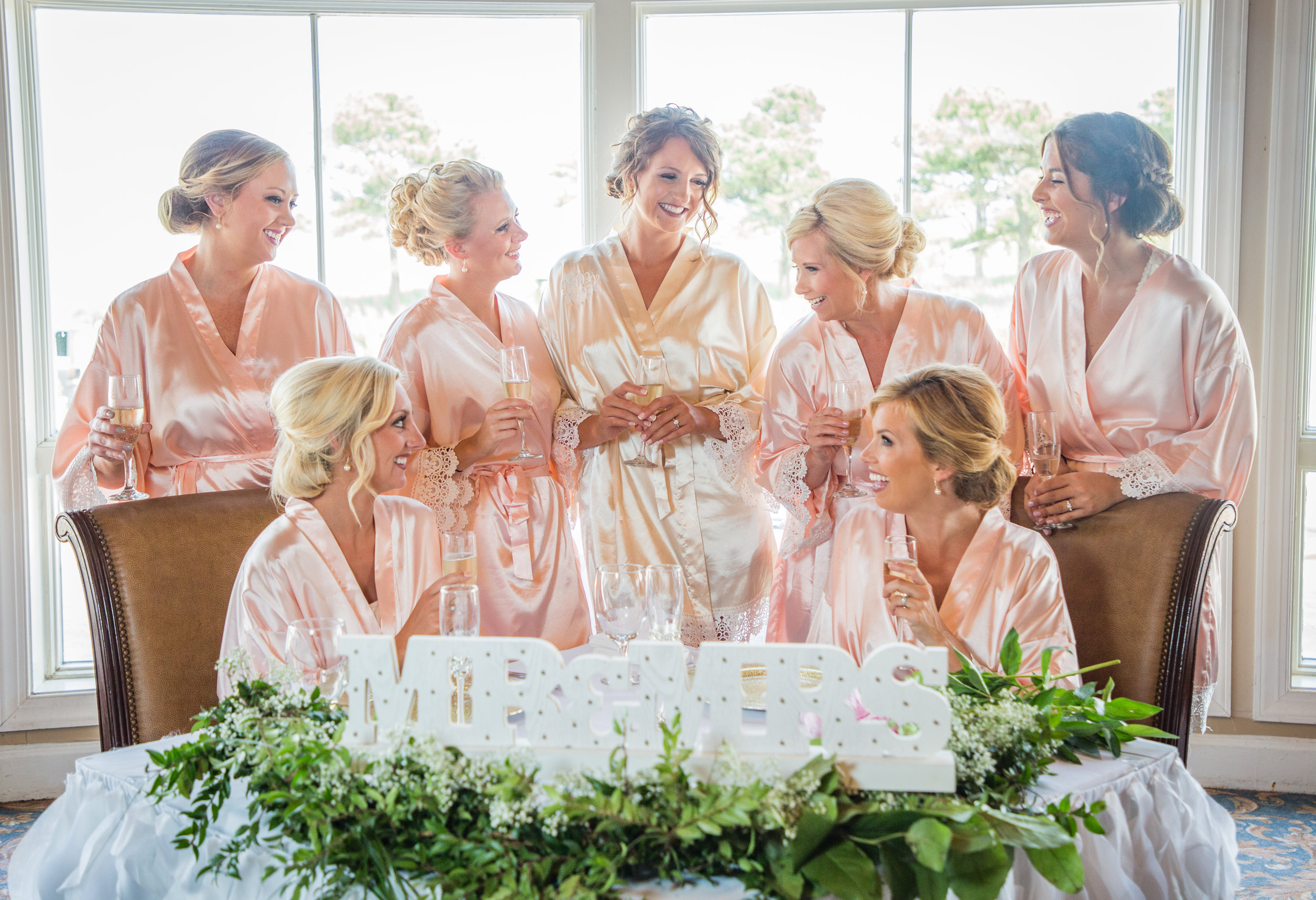 Bride with her bridesmaids get ready for the wedding at Lighthouse Sound. Planning and styling by  https://alisontothealtaroc.com/