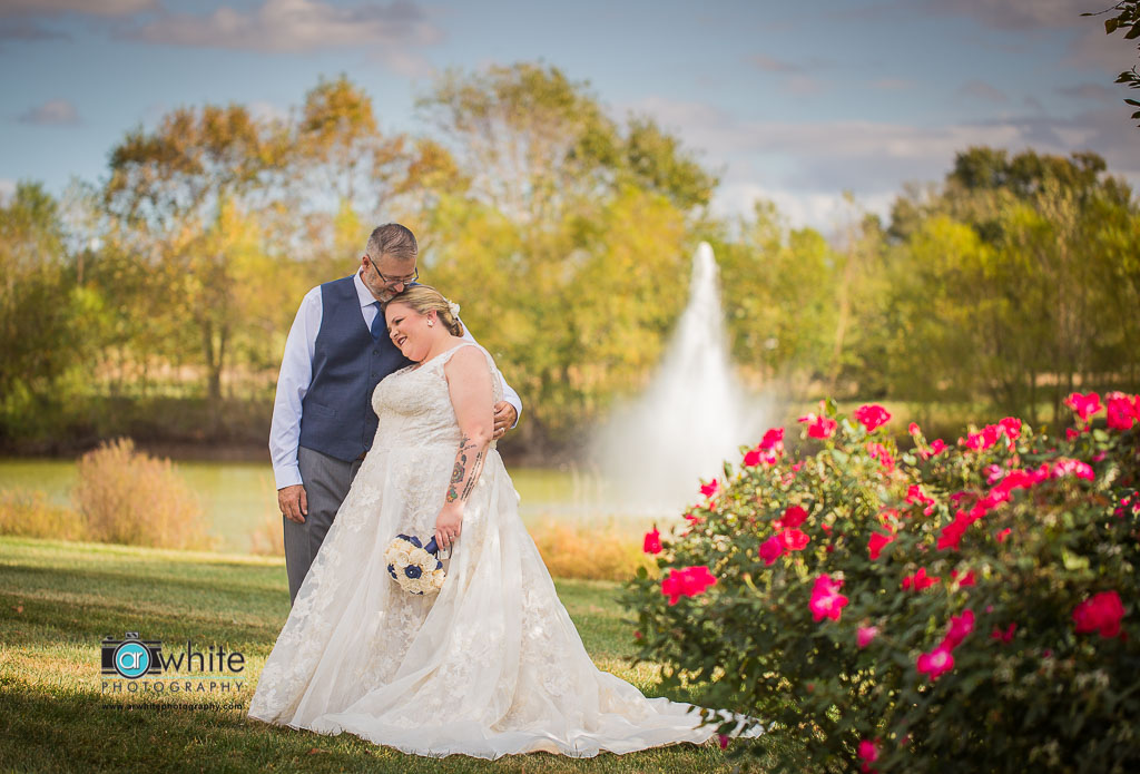 The scenery at Heritage Shores wedding venue is so beautiful. The red rose bushes and large fountain are just a short golf cart ride away.