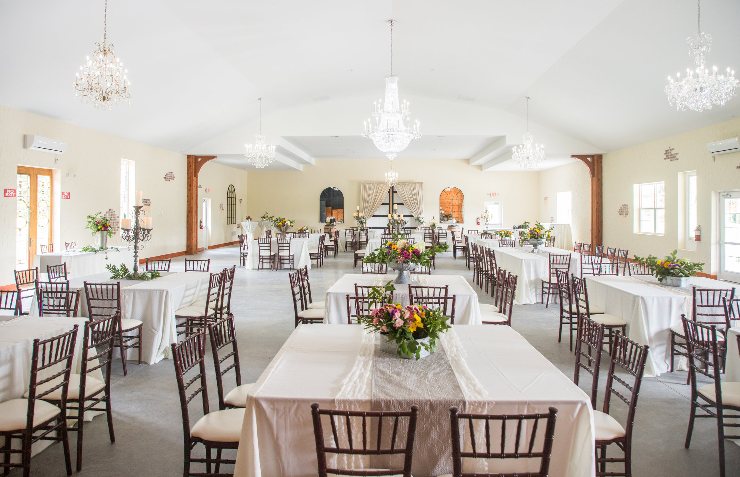 Smokey Hollow's interior is bright and elegant without being too rustic. Located in Selbyville, De, the wedding venue is situated on a field surrounded by trees. It is secluded, despite being only minutes from the famous Delaware beaches.