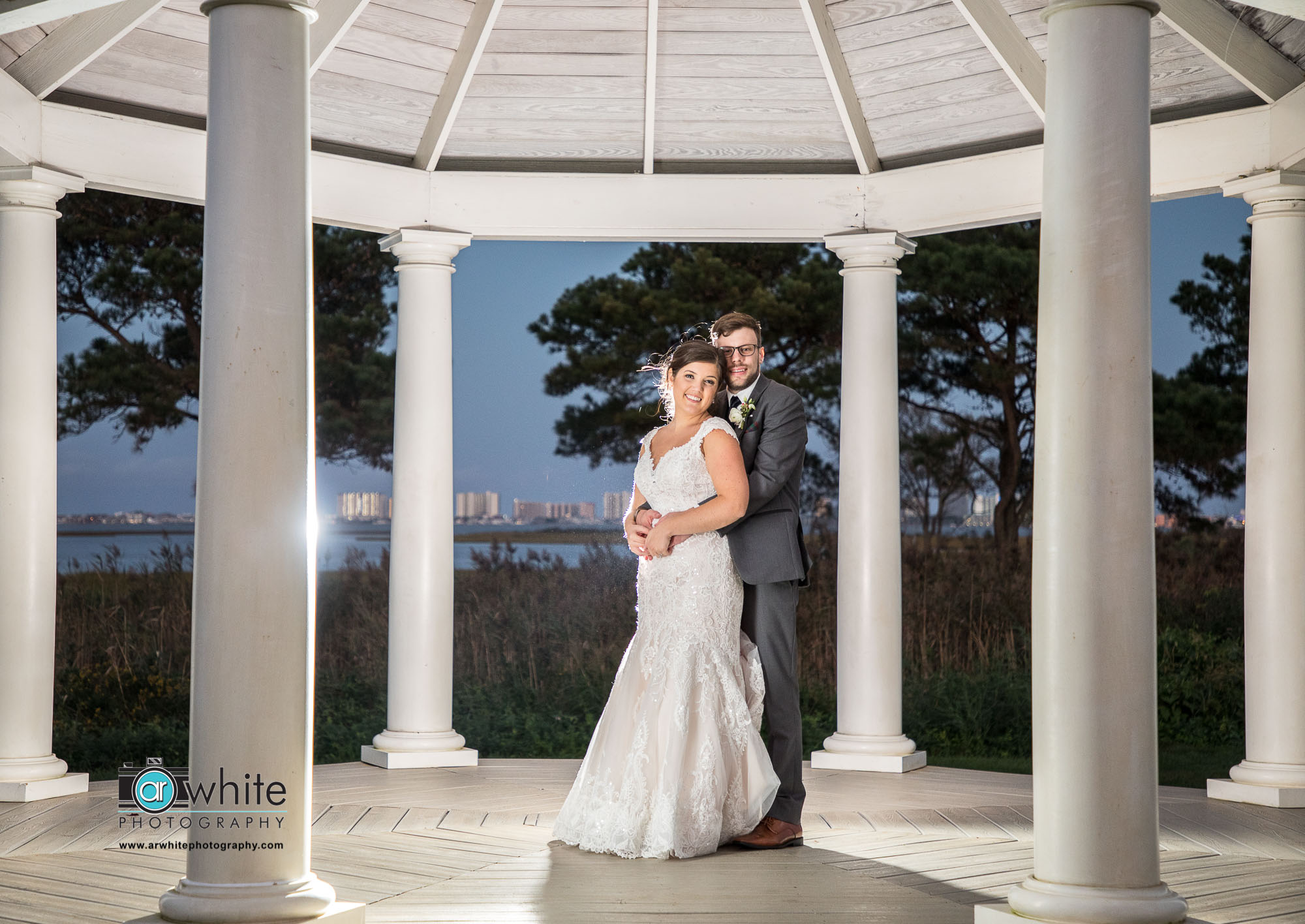 We were able to sneak away during the reception for a couple quick photos at twilight in the gazebo. I love how visible Ocean City is in the background.