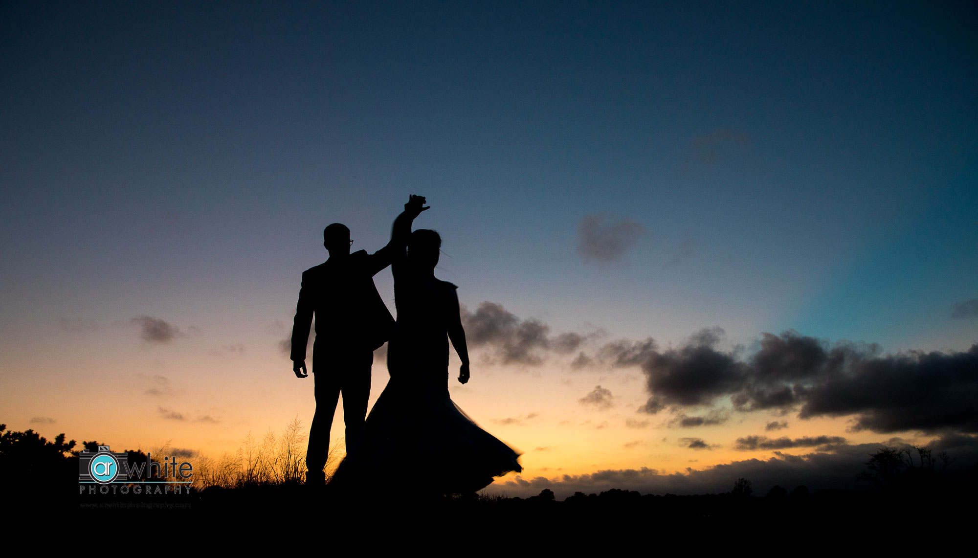 Silhouette of a bride and groom on their wedding day at Lighthouse Sound.