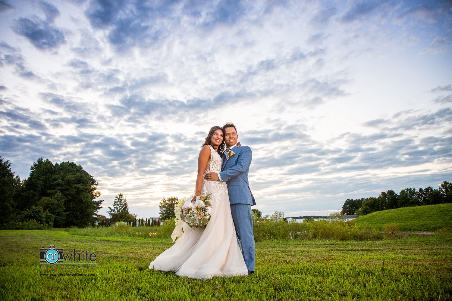 Bride and groom portrait at sunset at Kylan Barn.
