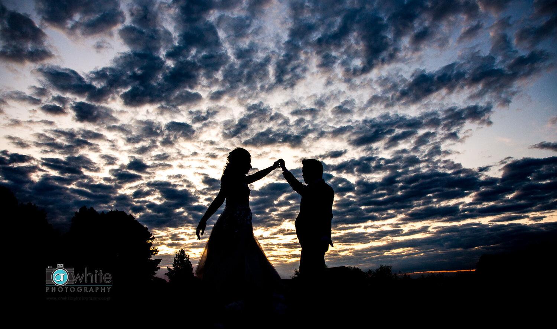 Silhouette of bride and groom at Kylan Barn wedding.