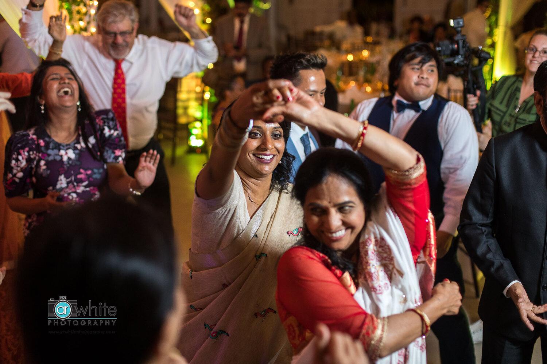Dancing during the reception at Kylan Barn wedding.