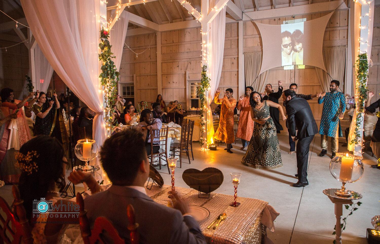 Traditional Indian performance at Kylan Barn wedding.