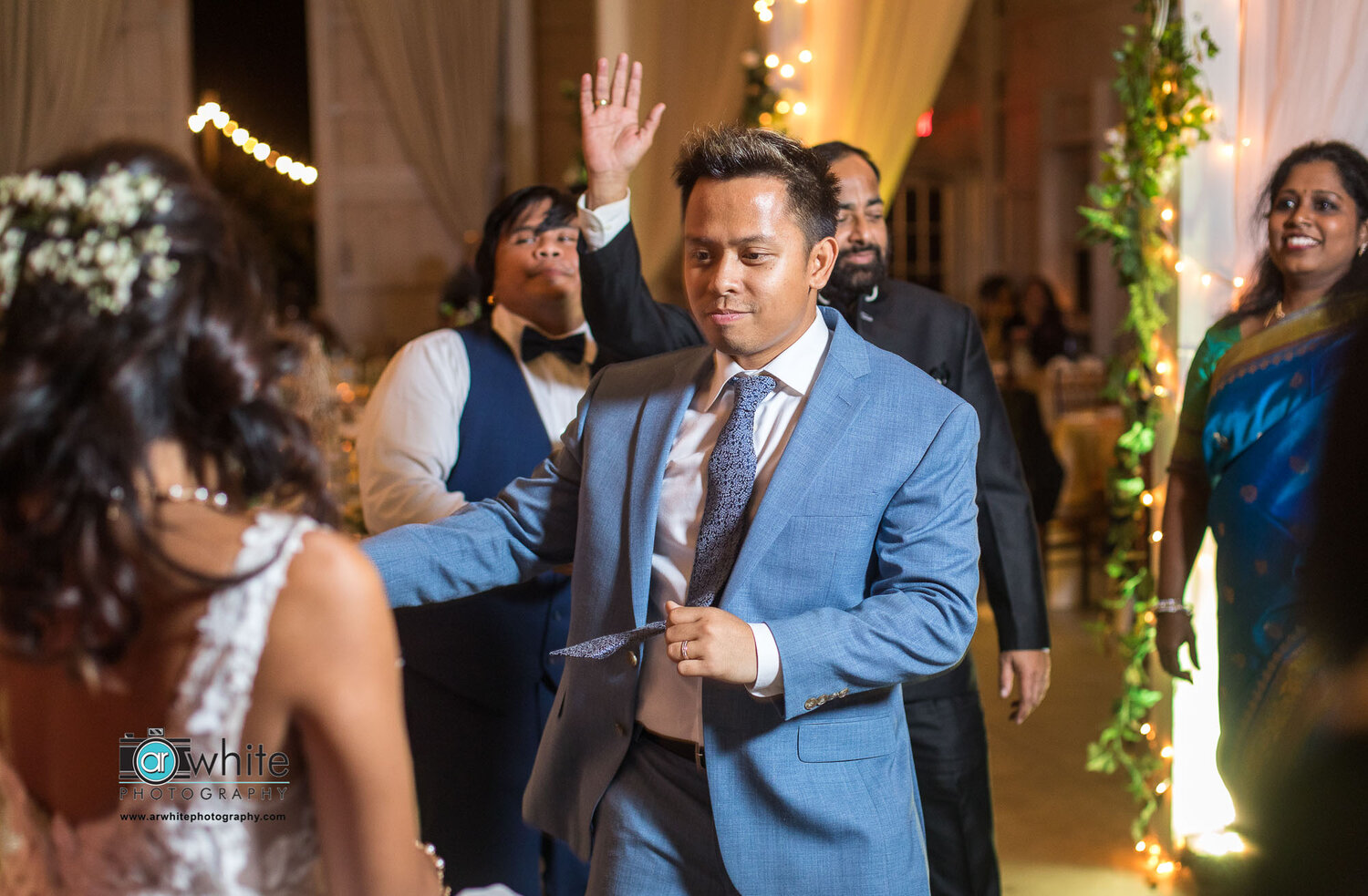 The groom dances with his wife at their wedding reception at Kylan Barn.