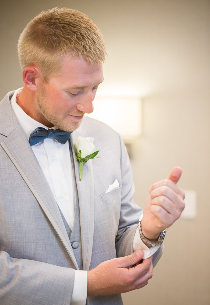Groom getting ready on wedding day at the Annapolis Waterfront Hotel.