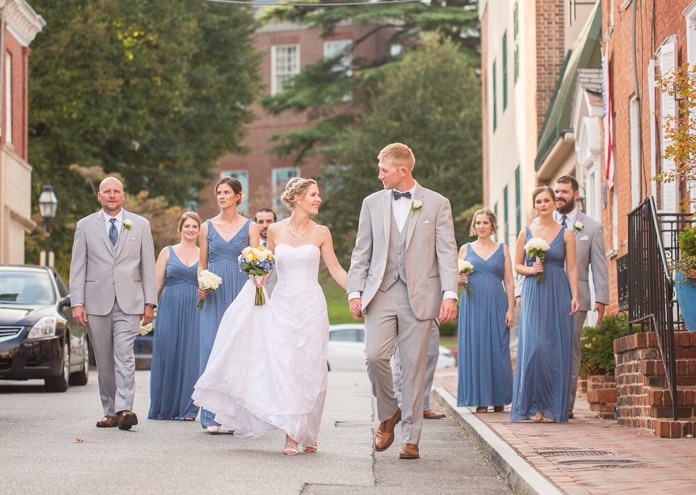 Couple with bridal party on wedding day in downtown Annapolis