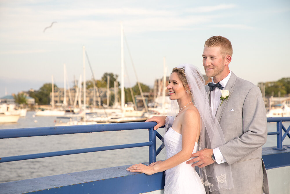 Bride and groom portrait overlooking the bay in Annapolis Md on wedding day.